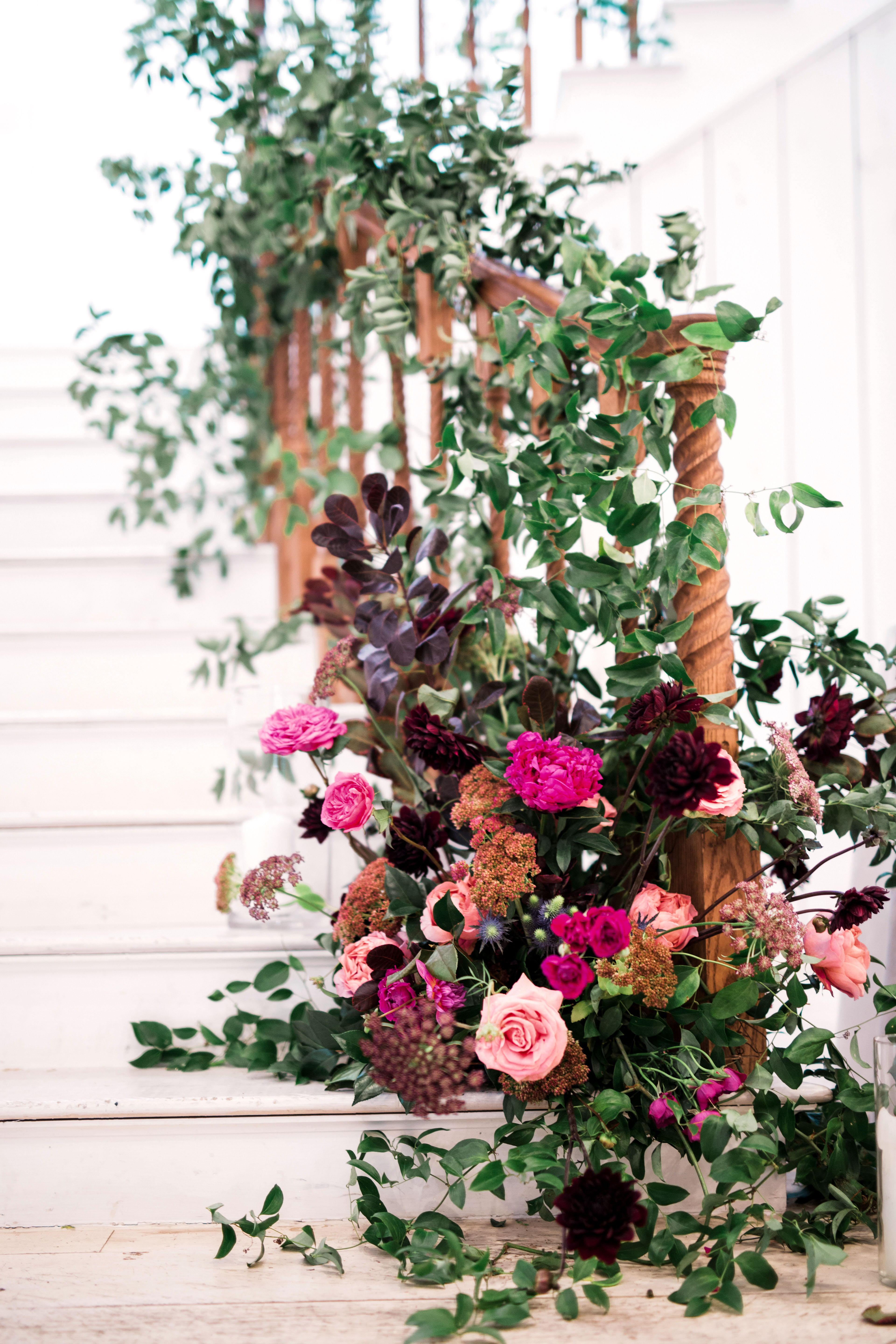 white stairwell banister decor pink roses natural wood