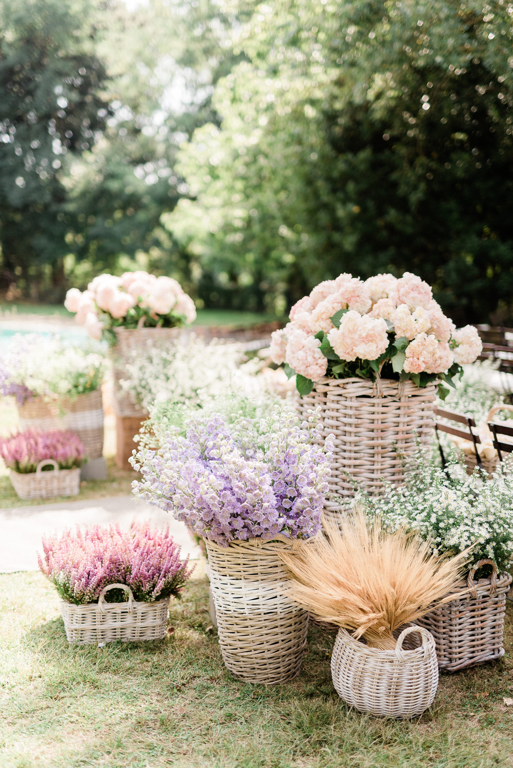 various sized wicker baskets holding pastel florals