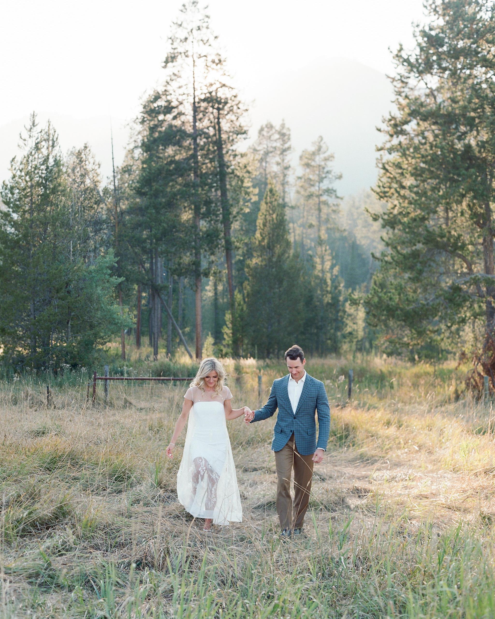 bride groom walking in wooded grass area