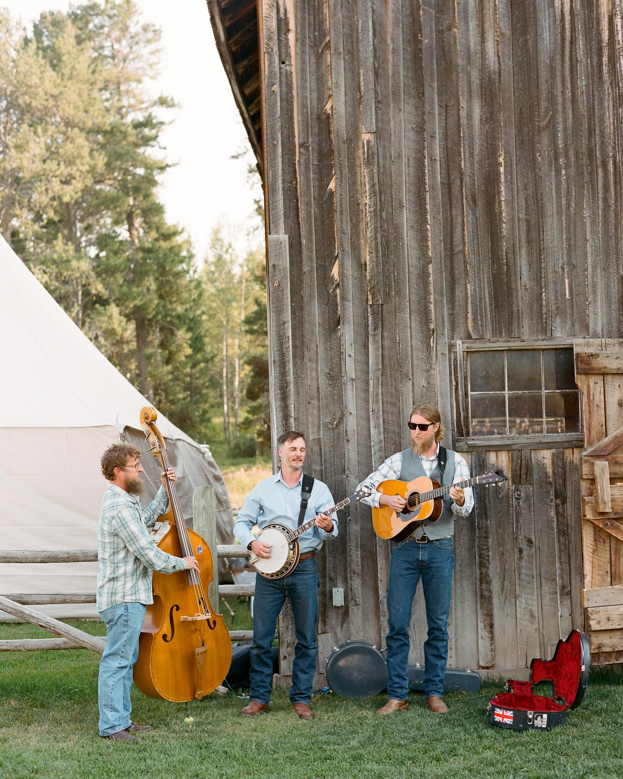 wedding band playing next to barn