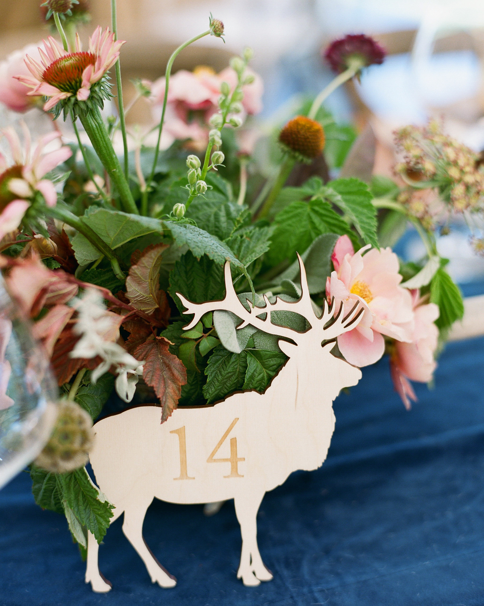 moose shaped table number with floral arrangement