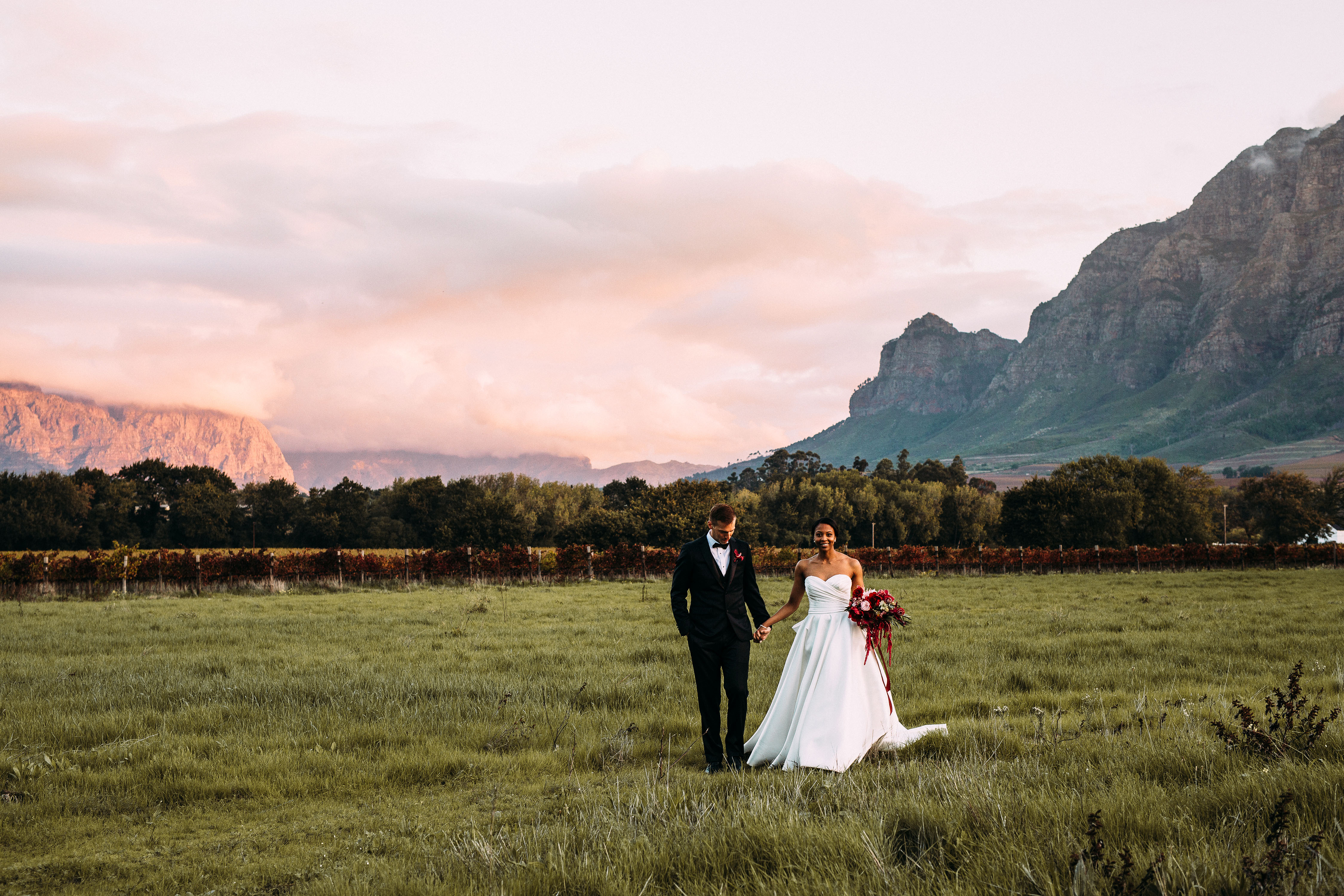 yolana douglas wedding couple in field in front of mountains