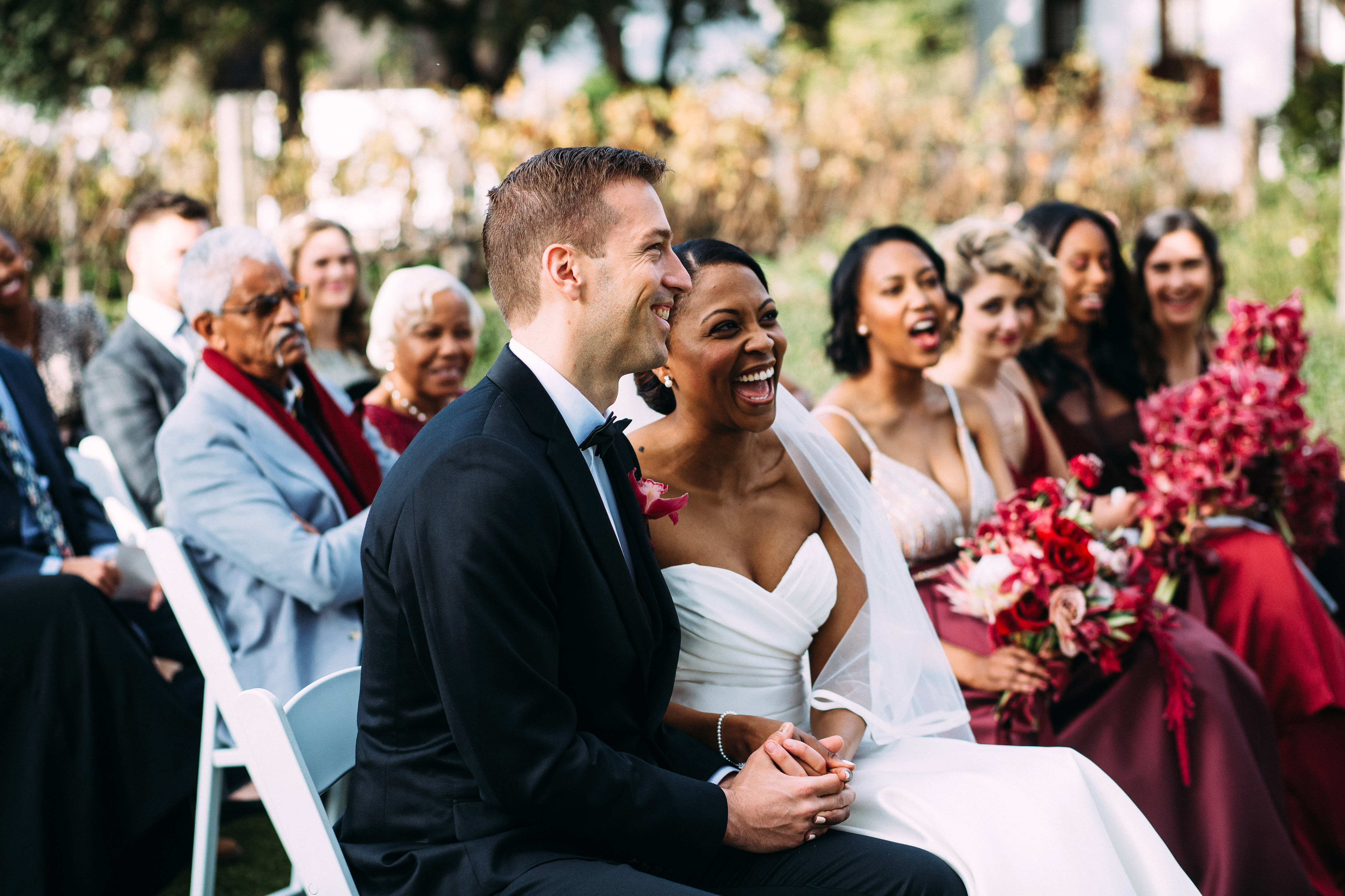 yolana douglas wedding ceremony couple seated laughing