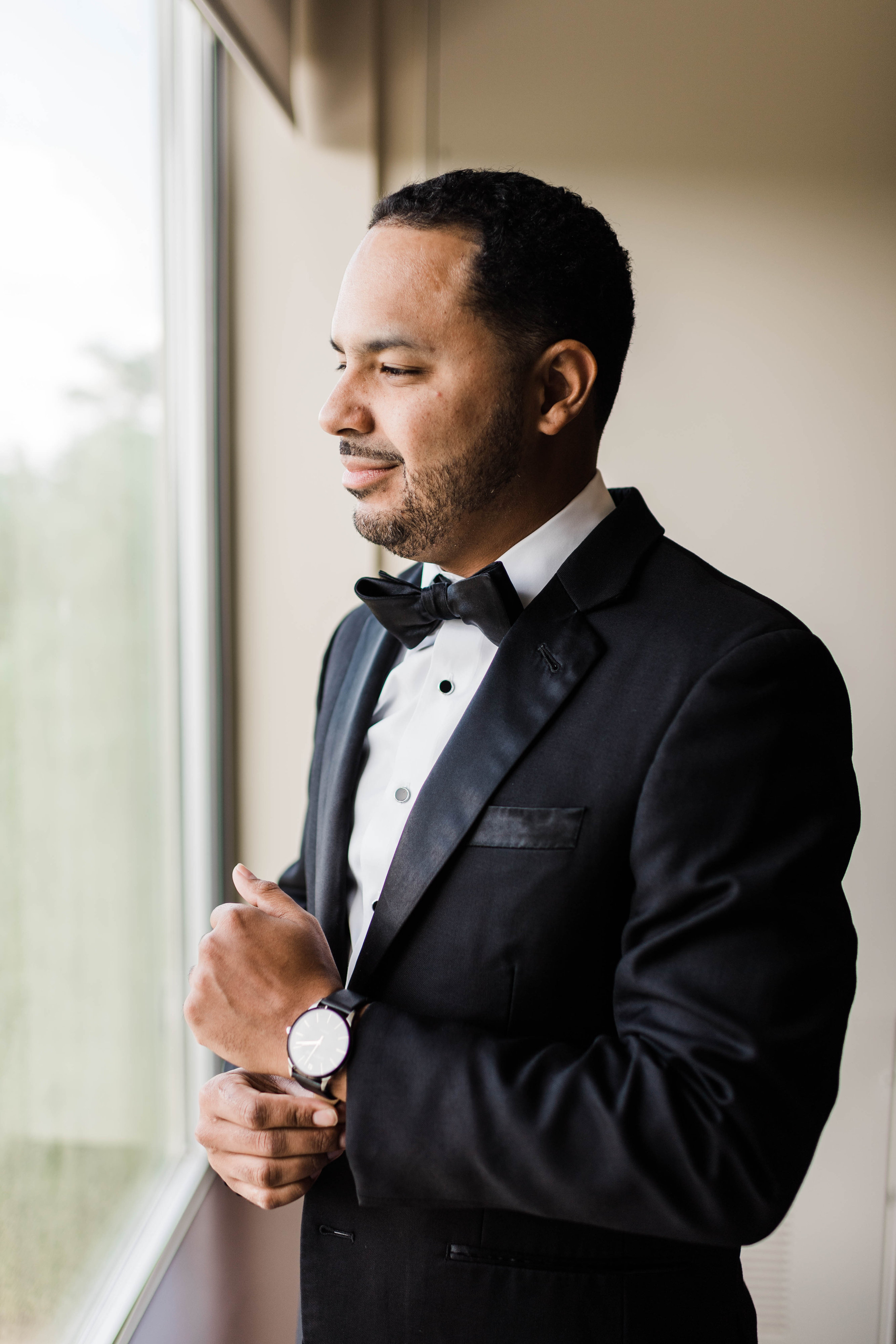 groom wearing traditional black tuxedo wedding look