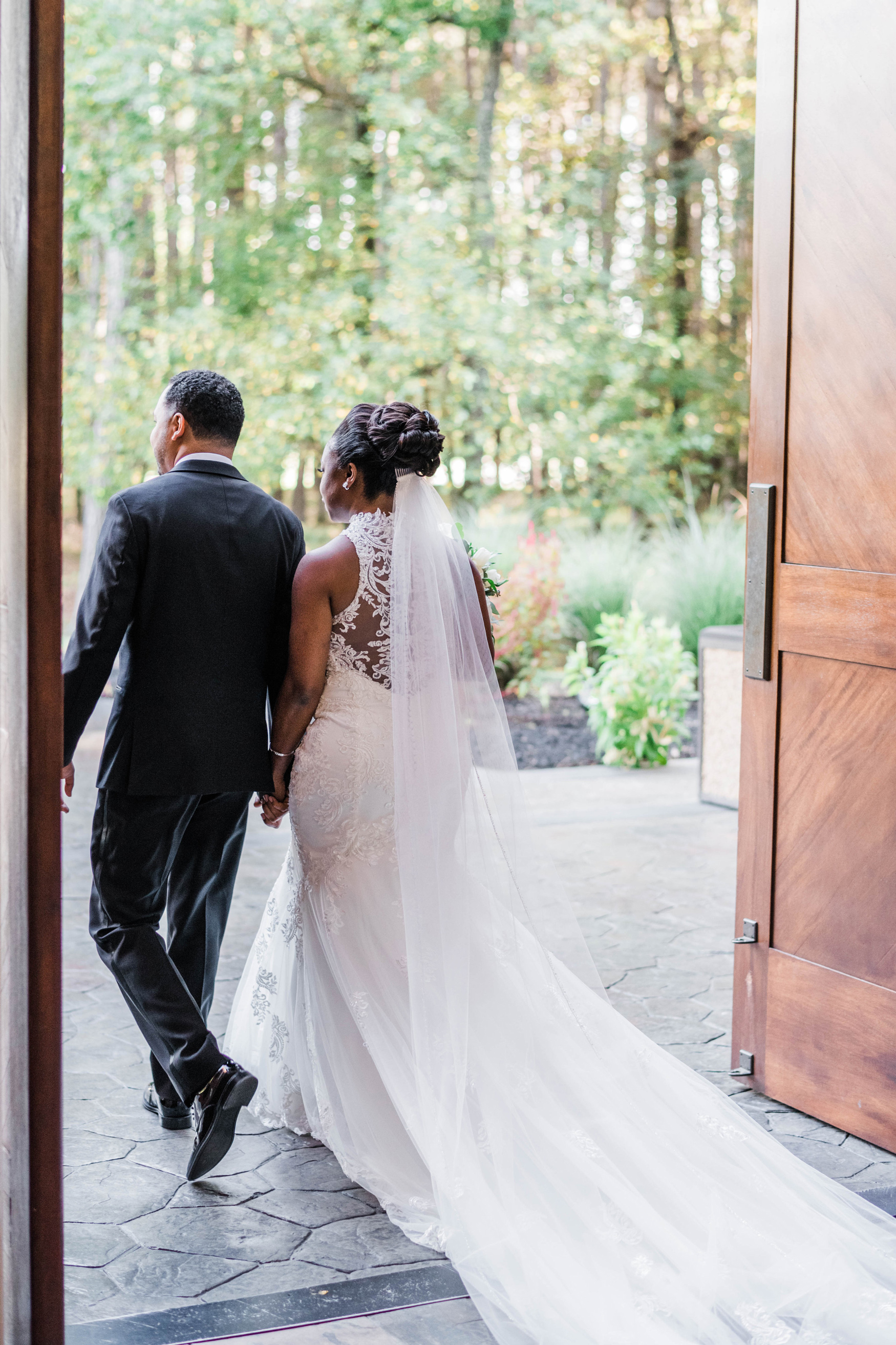 bride and groom exiting the church after wedding ceremony