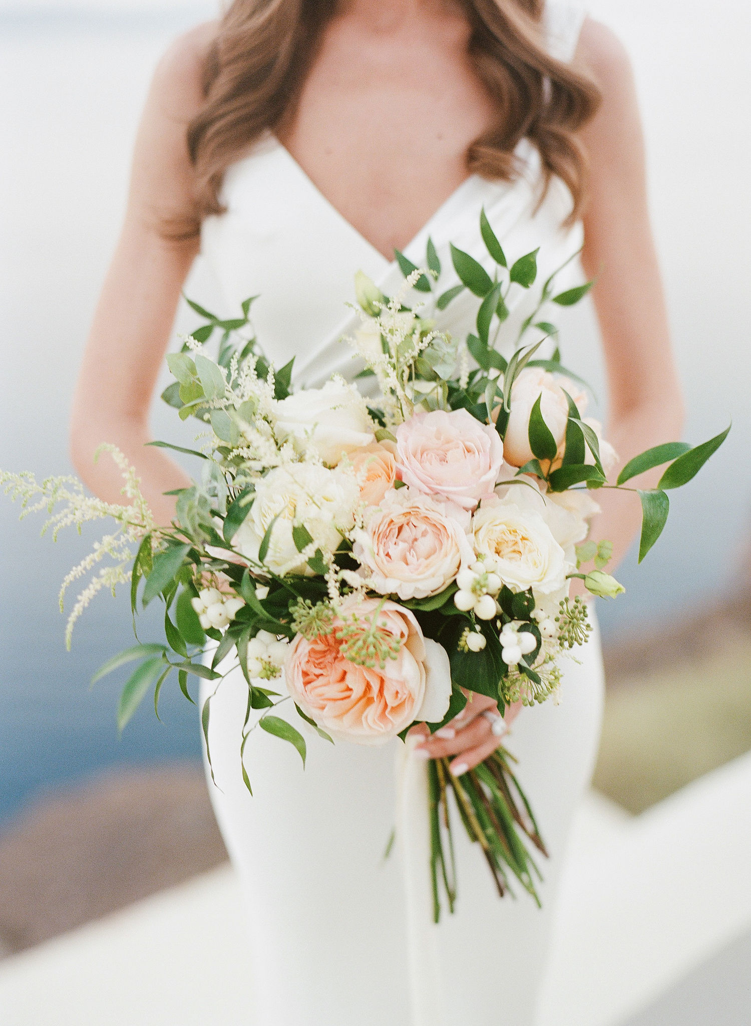 pastel colored garden roses, standard roses, lisianthus and foliage bouquet