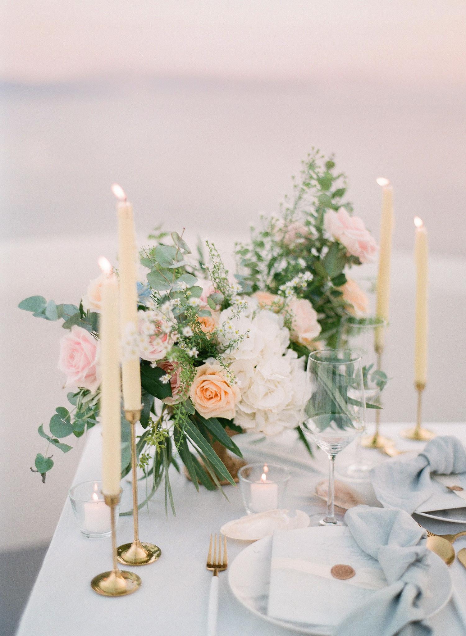 taper candles, seafoam linens, floral arrangement dinner table decor