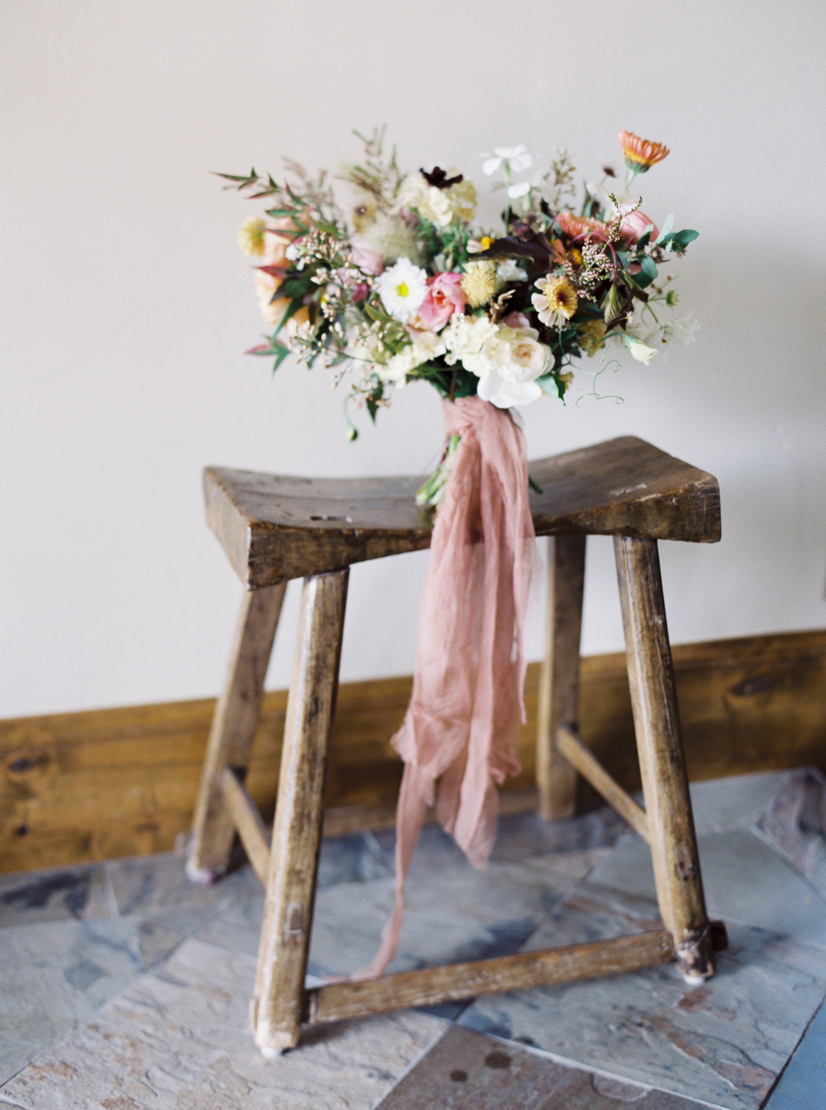 pink, white, coffee, and walnut tones floral arrangement