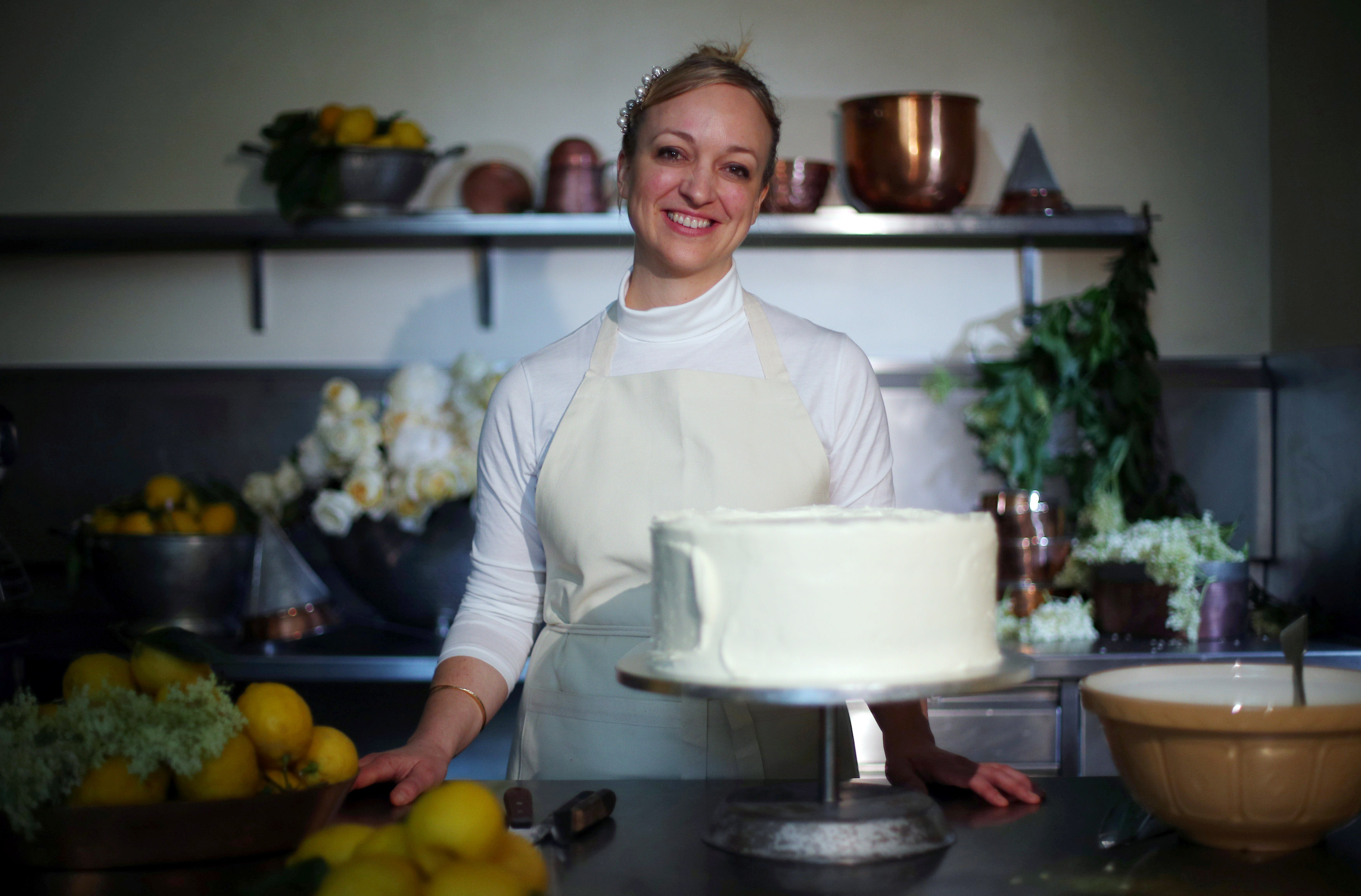 claire ptak posing with the royal wedding cake