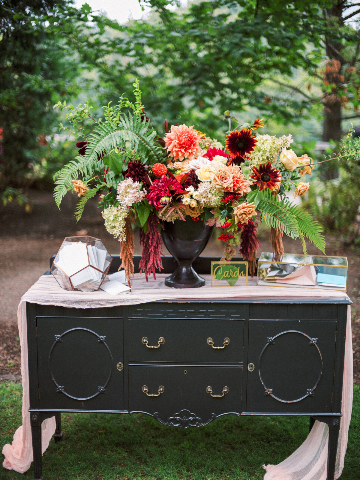 black antique buffet table for guests cards