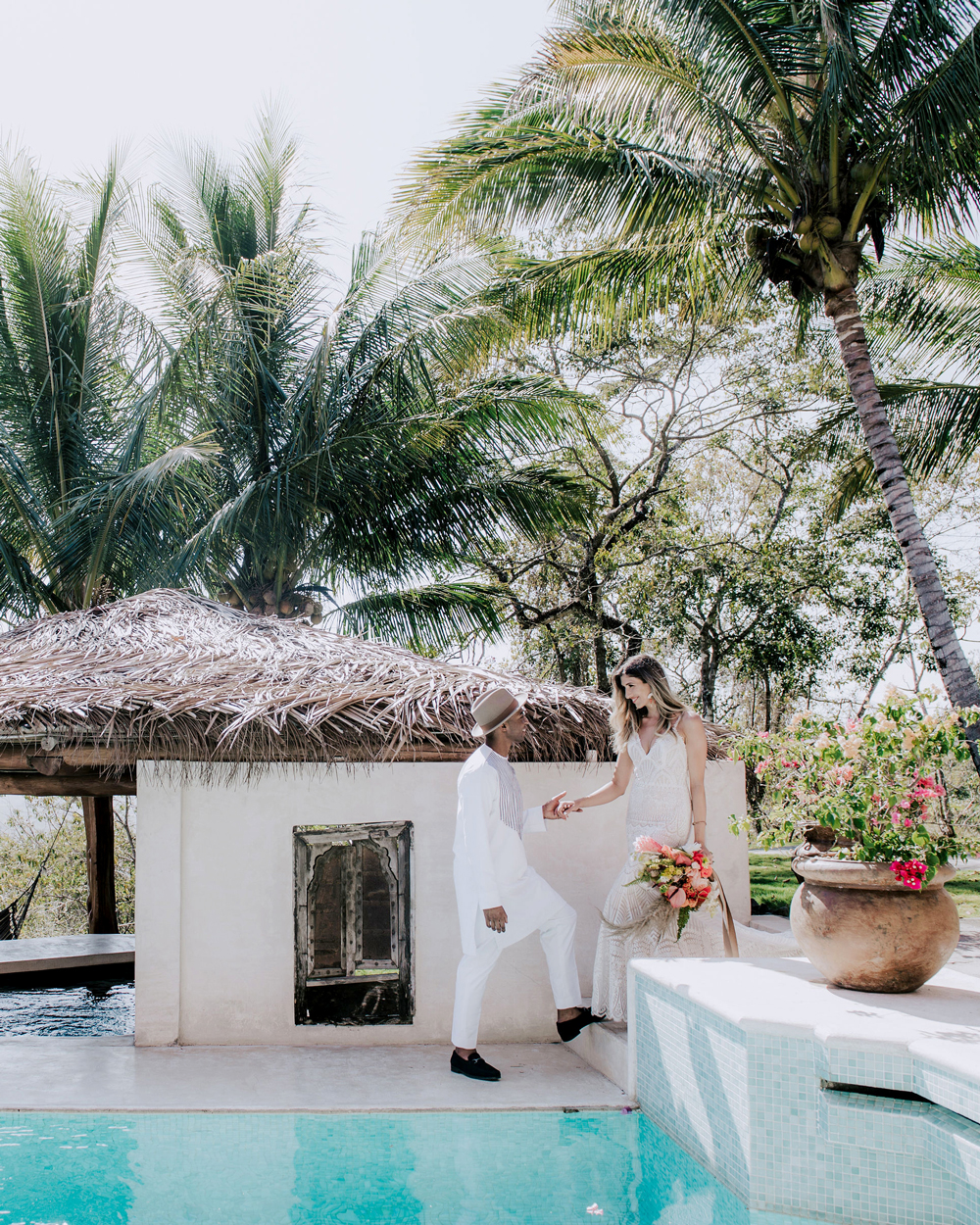 bride and groom share first look before ceremony at venue pool