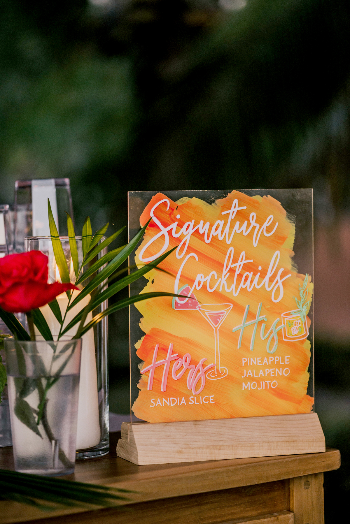 orange painted glass signature cocktail sign on wooden table