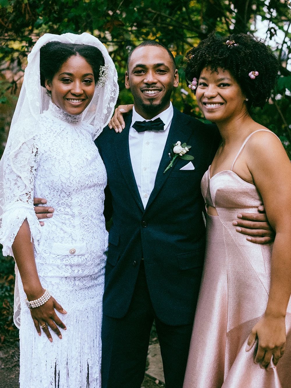 bride, groom, and bridesmaid