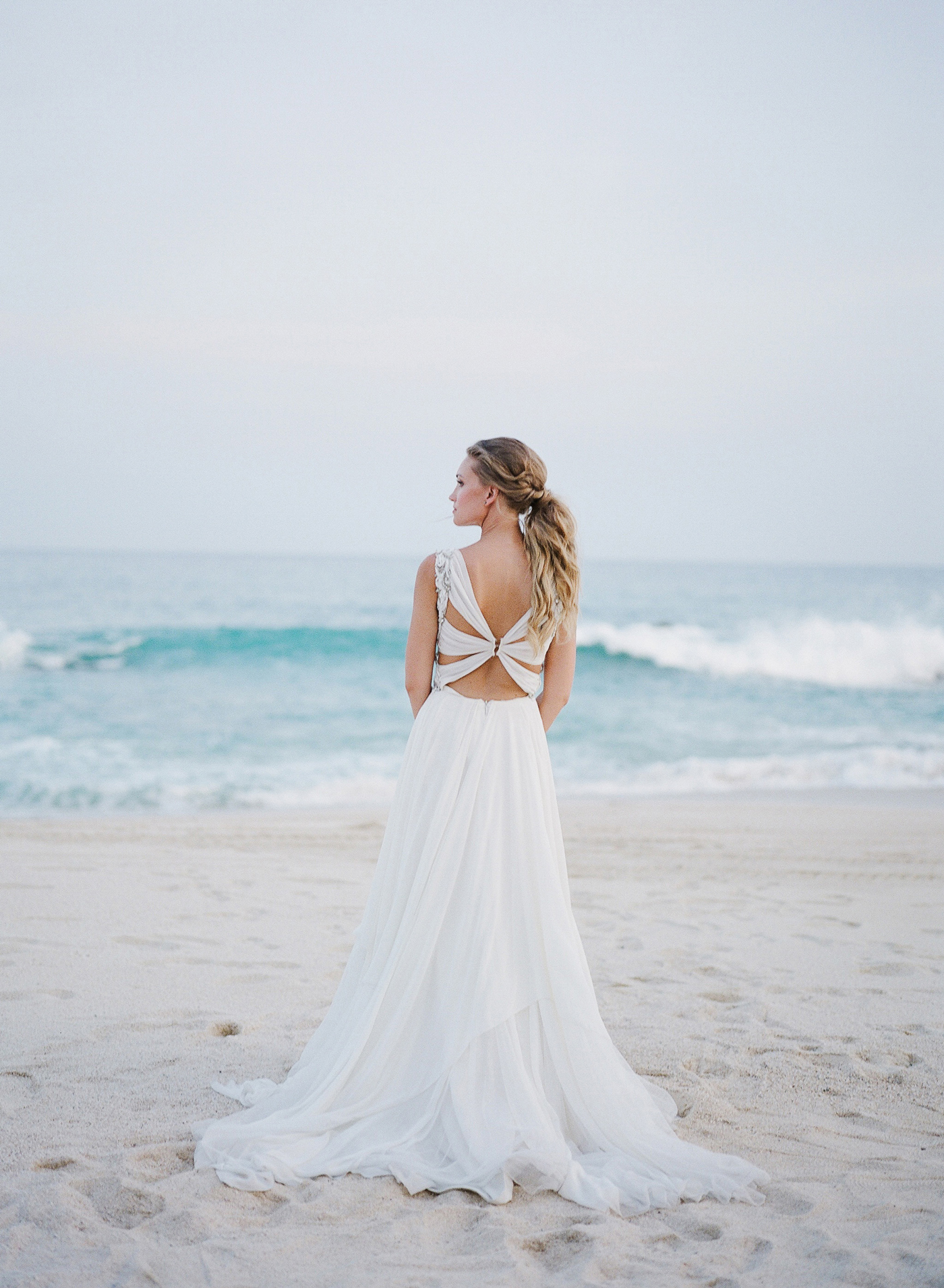 bride wearing wedding dress with cut-outs