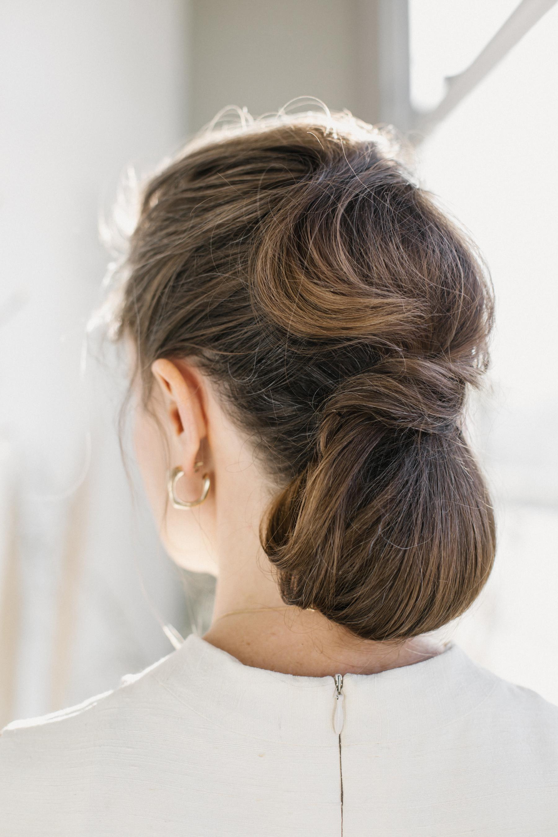 bride low bun hairstyle elongated waves