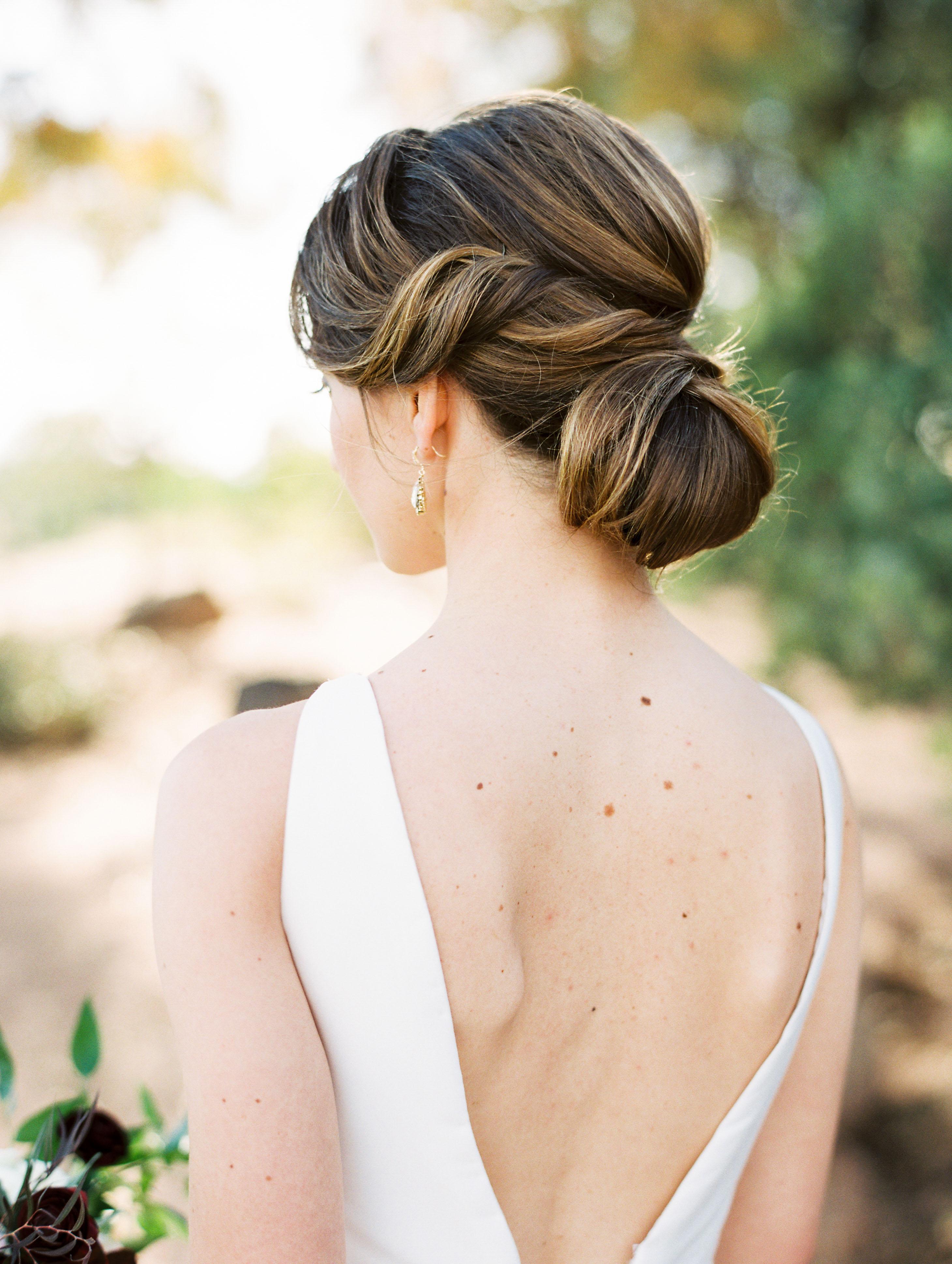 bride low bun hairstyle spiral volume