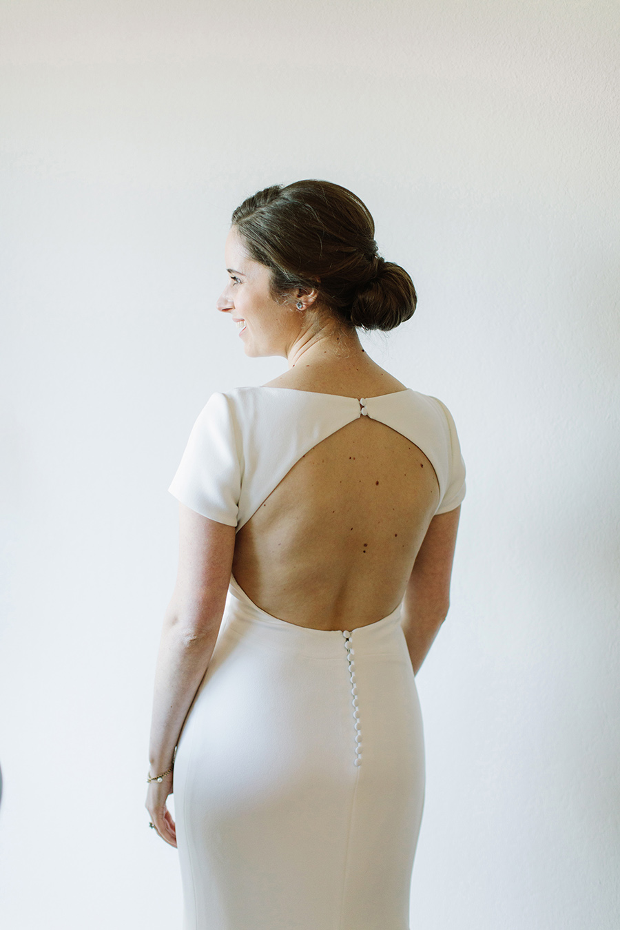 a matte cream, open-backed, elegant minimal mermaid gown