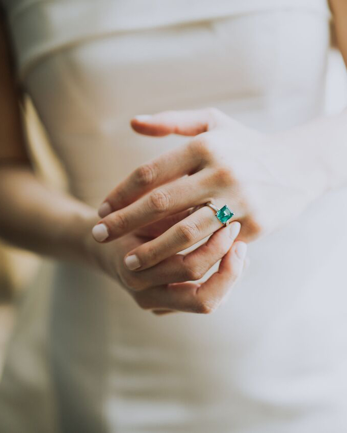 cathleen and winston wedding bride wearing emerald ring