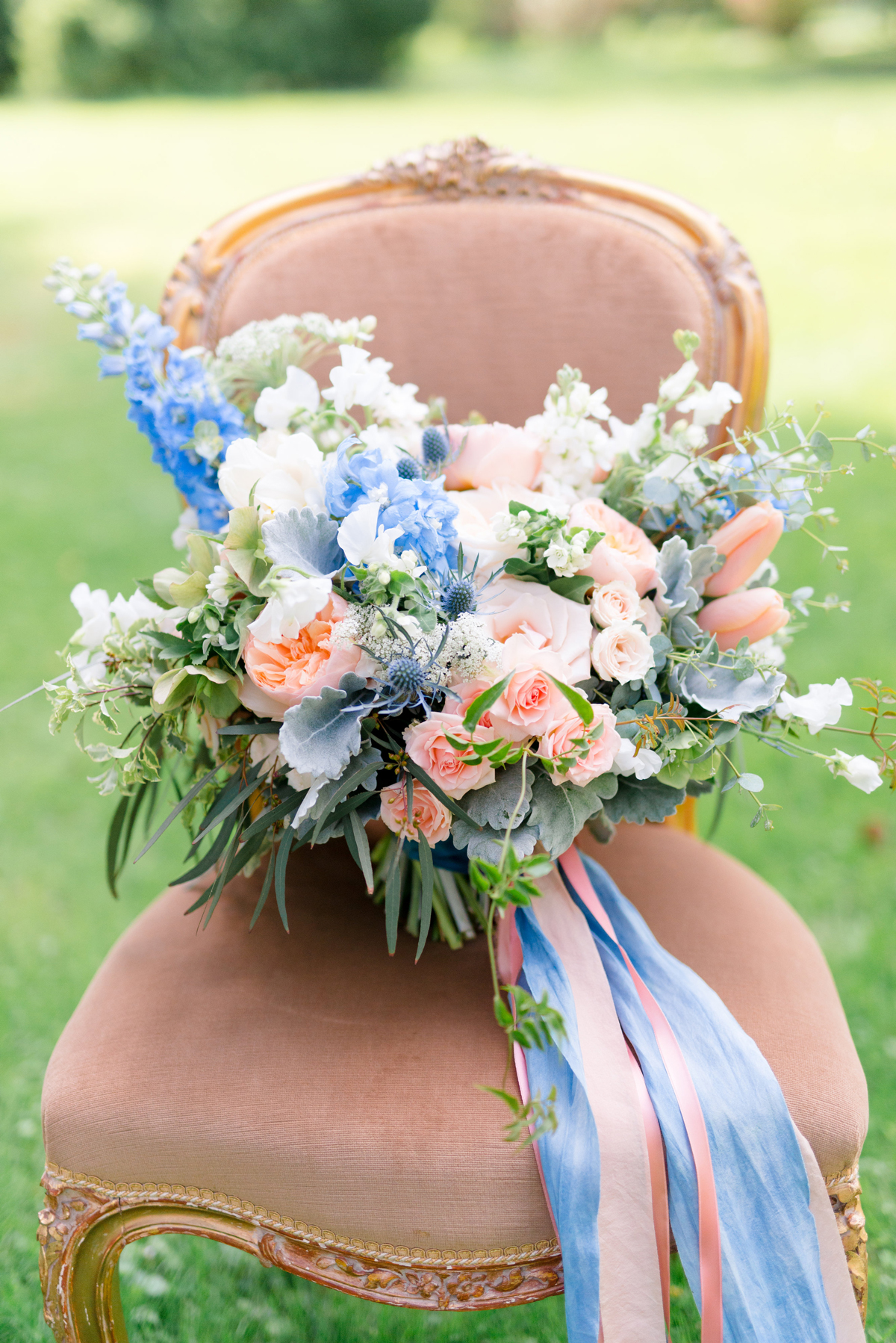 pink and blue floral wedding bouquet with matching ribbons