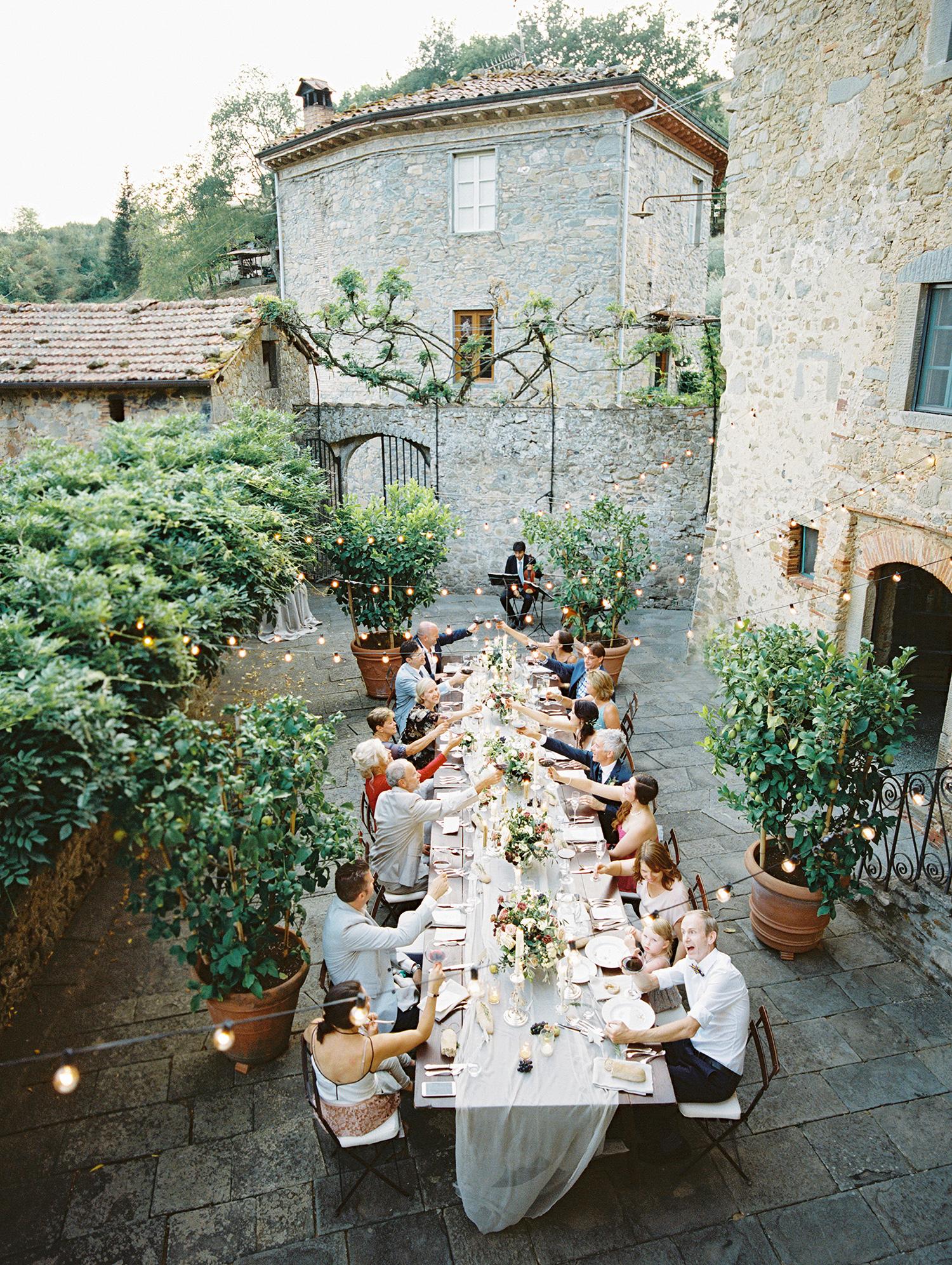 kelly pete wedding outdoor reception guests cheers