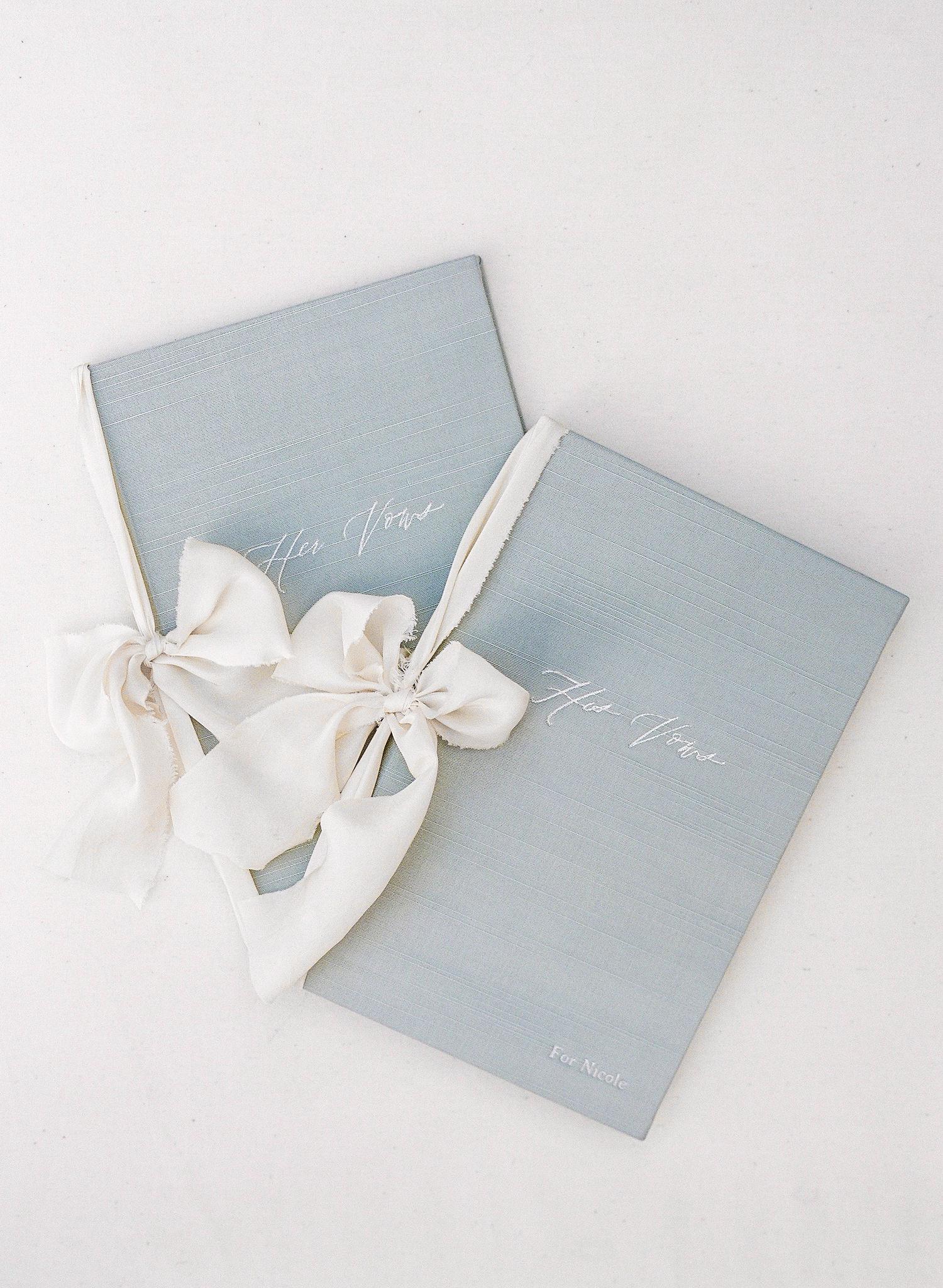 vow books white raw edge bows