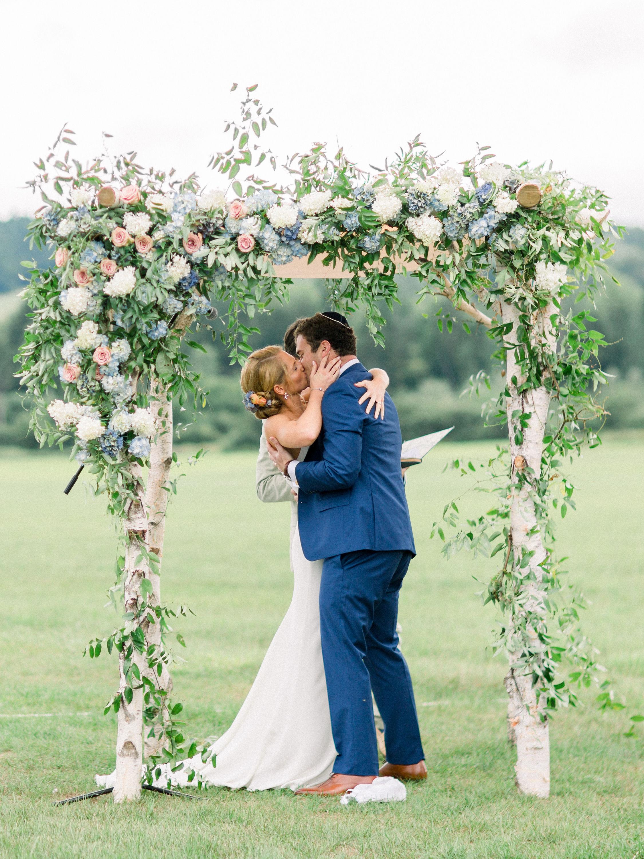 lauren josh wedding ceremony kiss under the arch