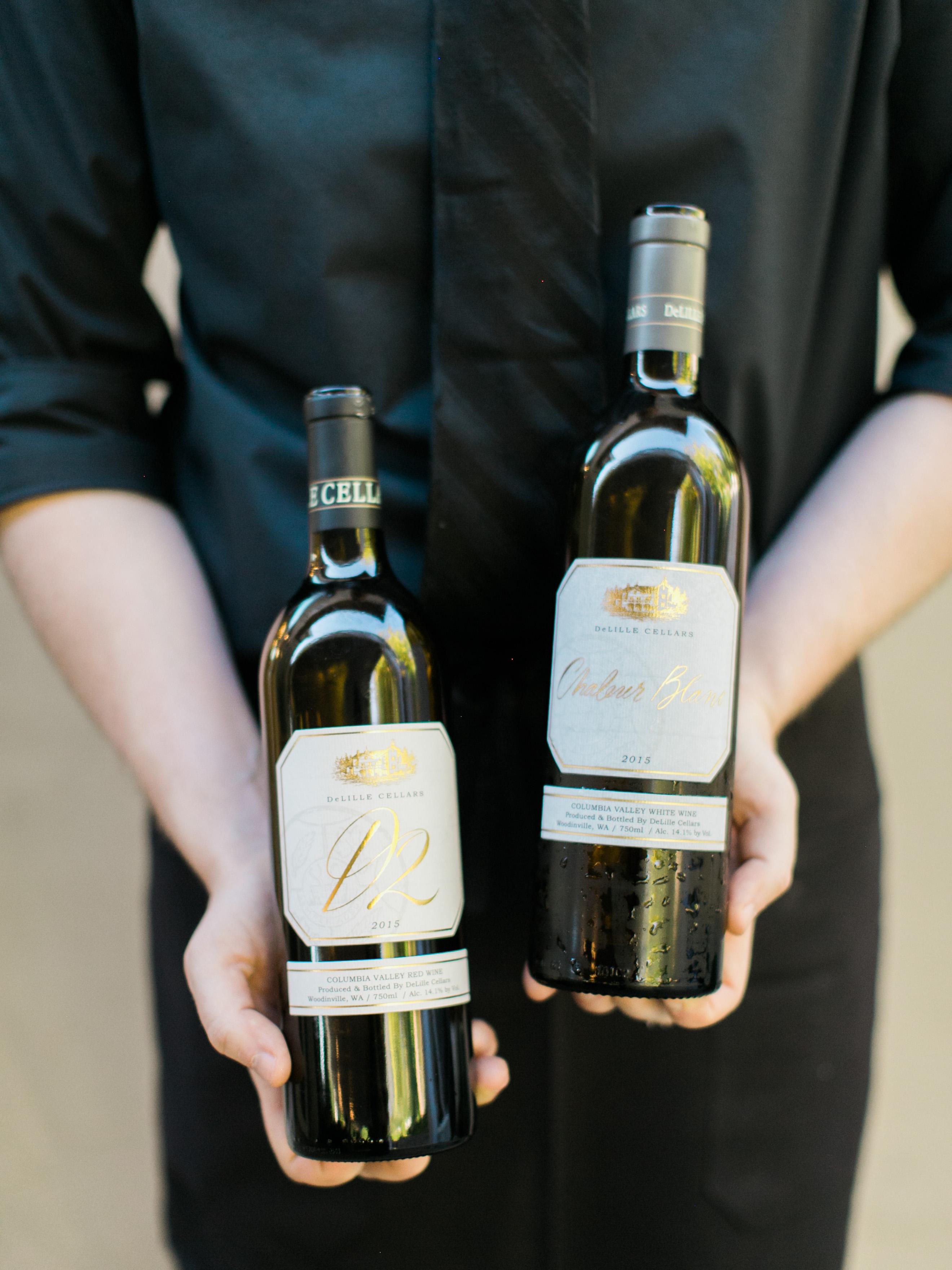 paige matt wedding person holding two bottles of wine