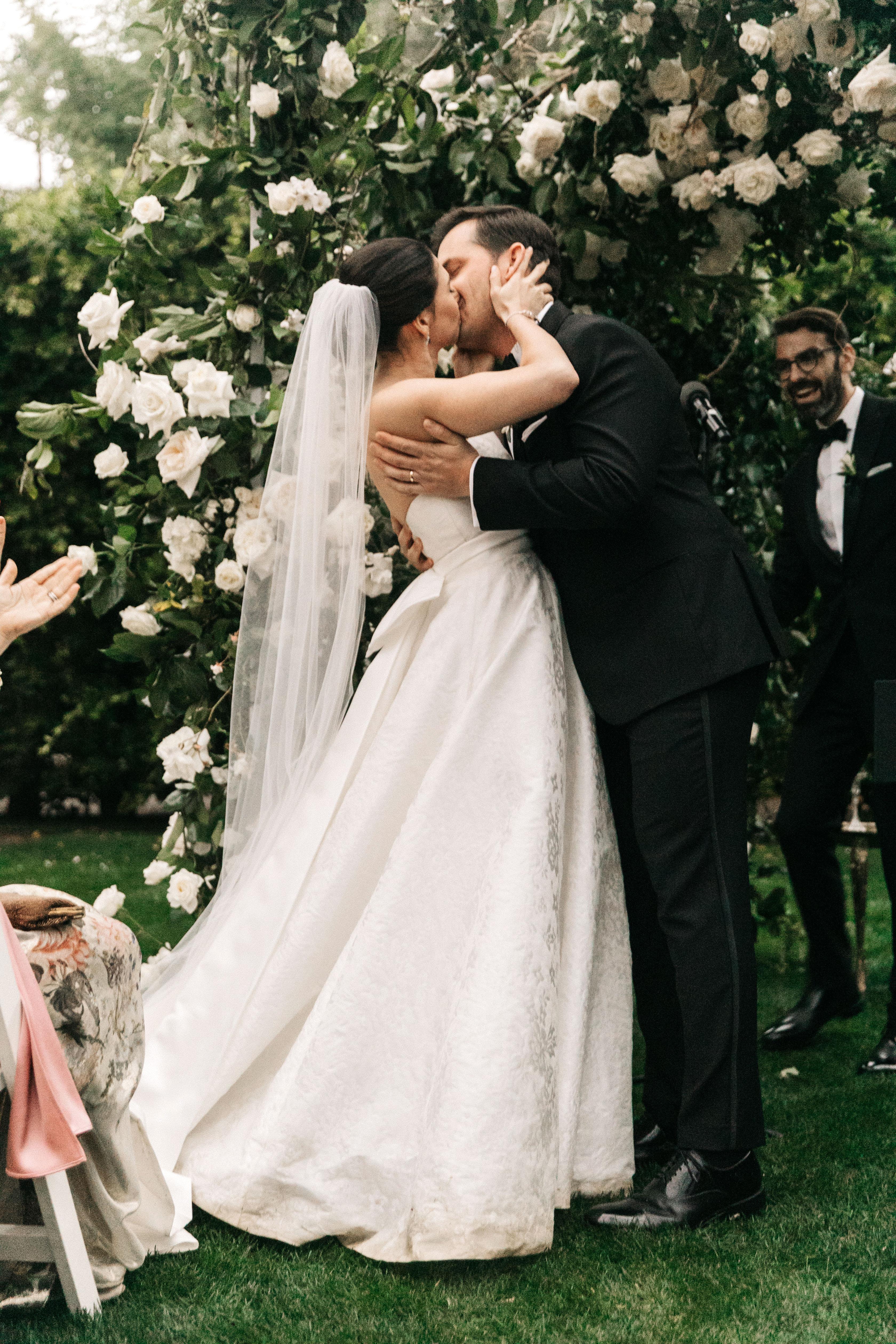 mia patrick wedding ceremony bride and groom kiss
