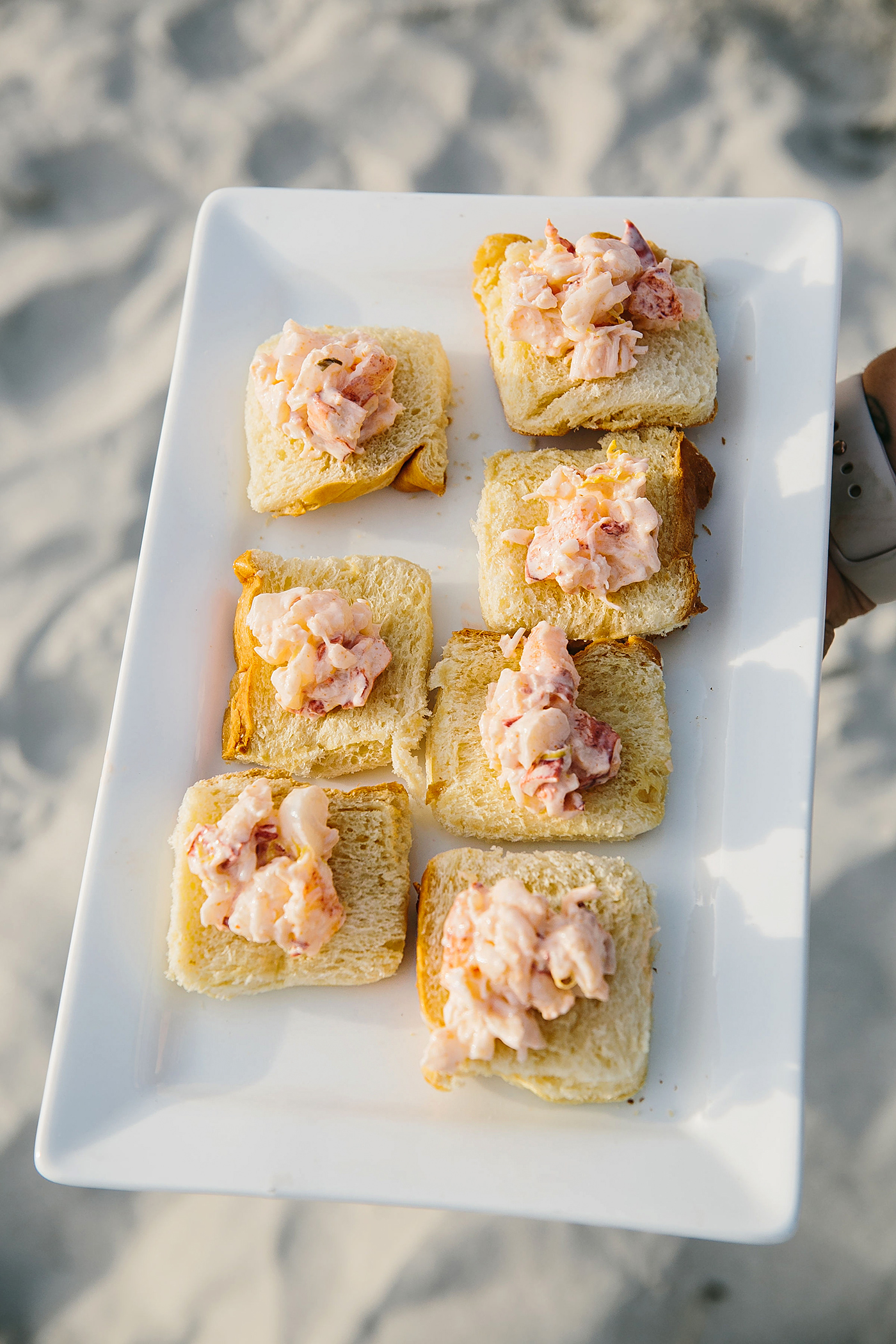 mini lobster rolls on platter