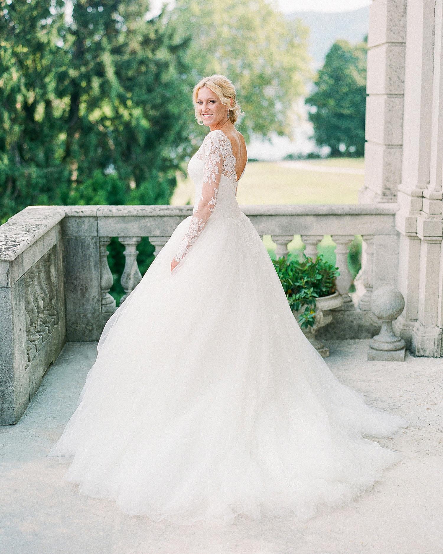 julia mauro wedding bride standing on balcony