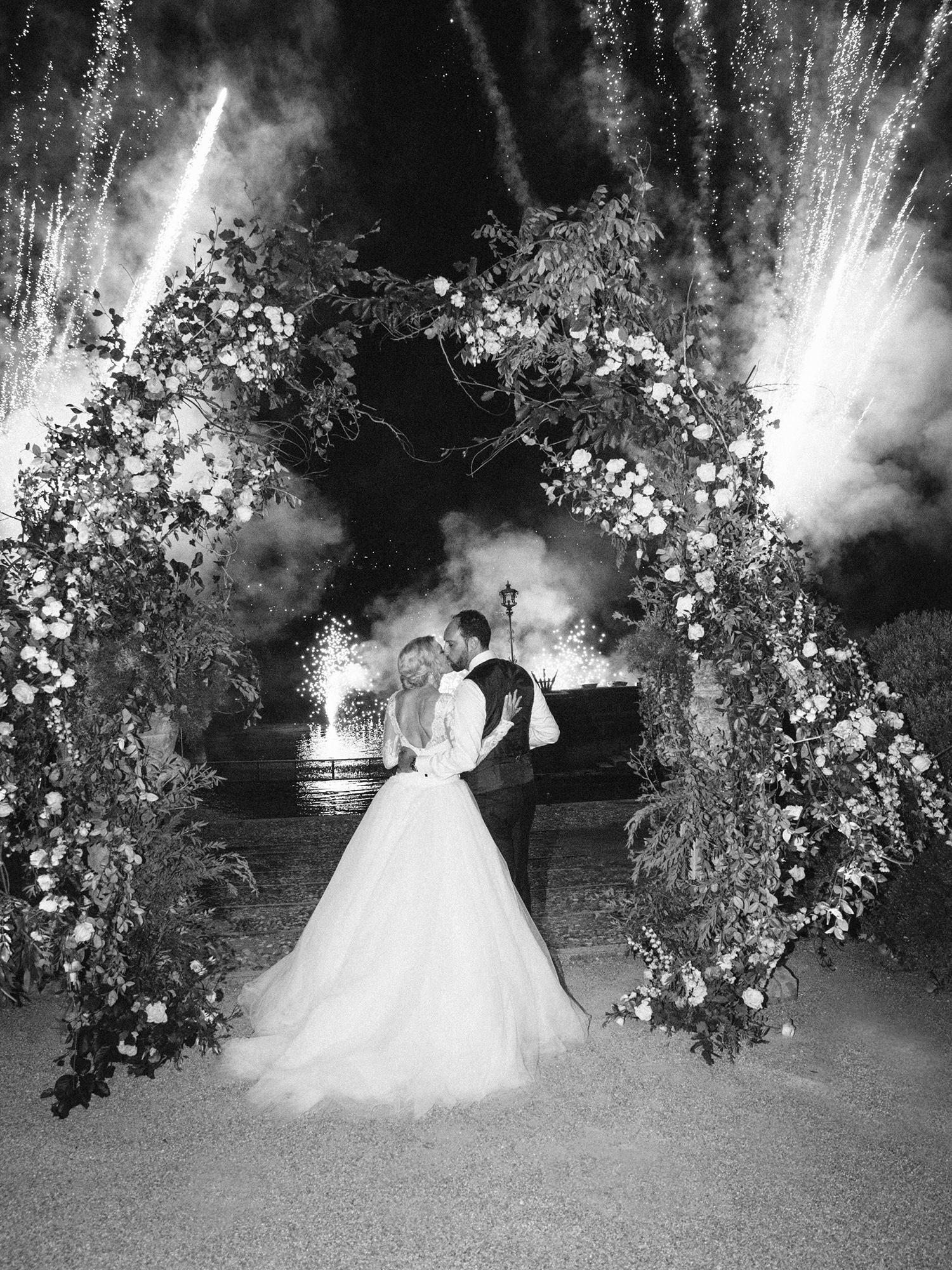 julia mauro wedding couple under fireworks