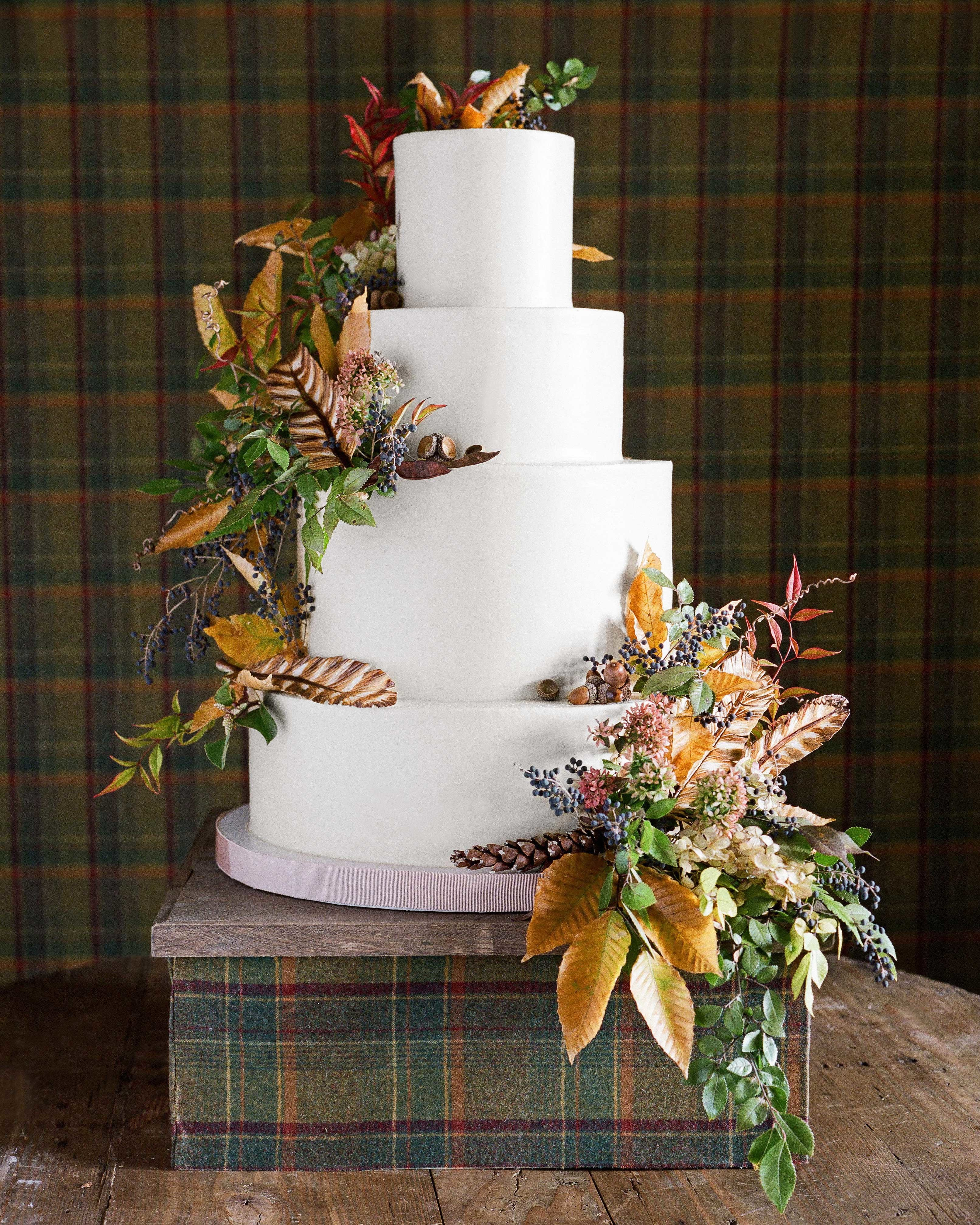 fall floral four tier wedding cake on gift box stand