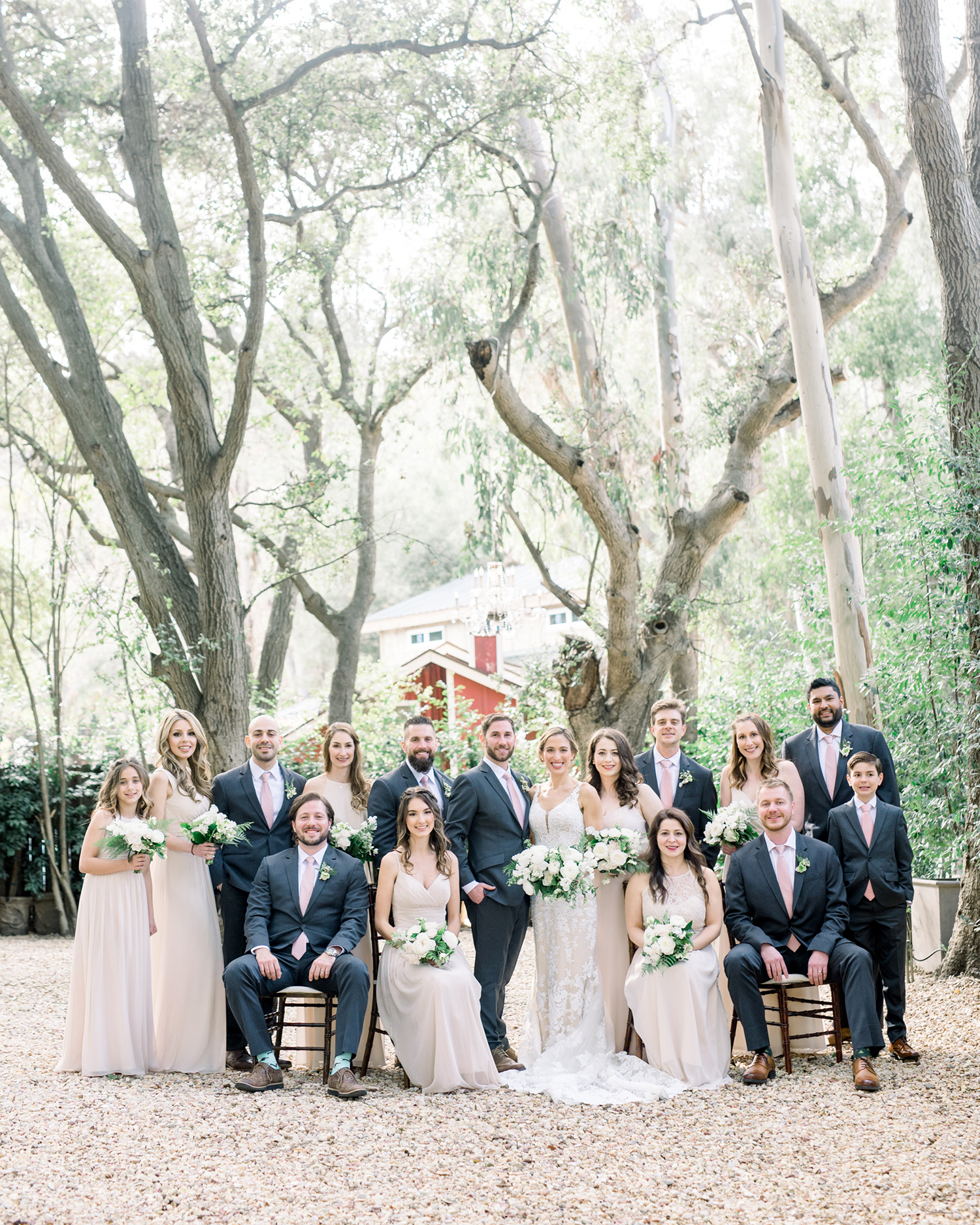 lauren aaron wedding party in front of trees