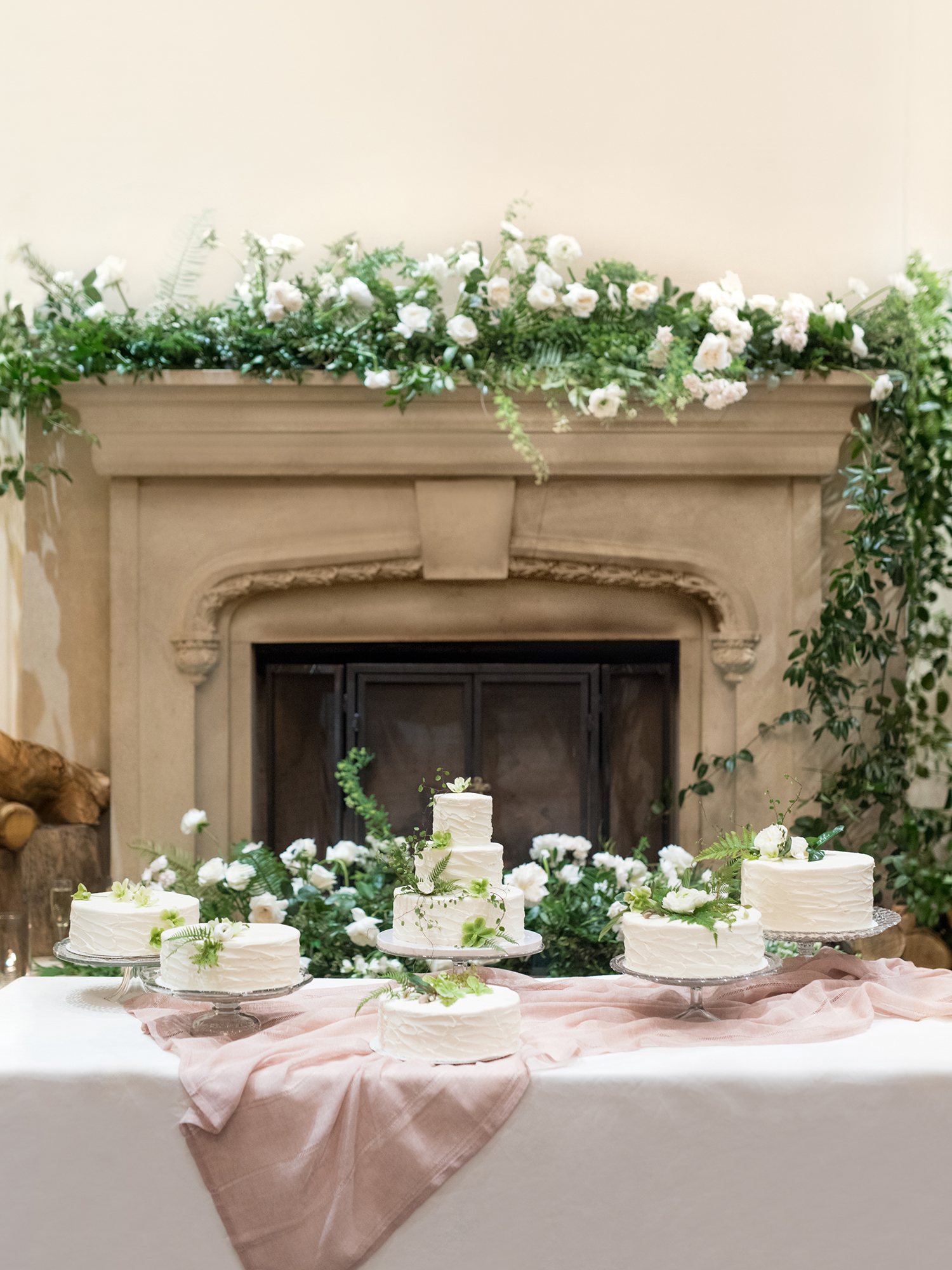 lauren aaron wedding cakes in front of fire place