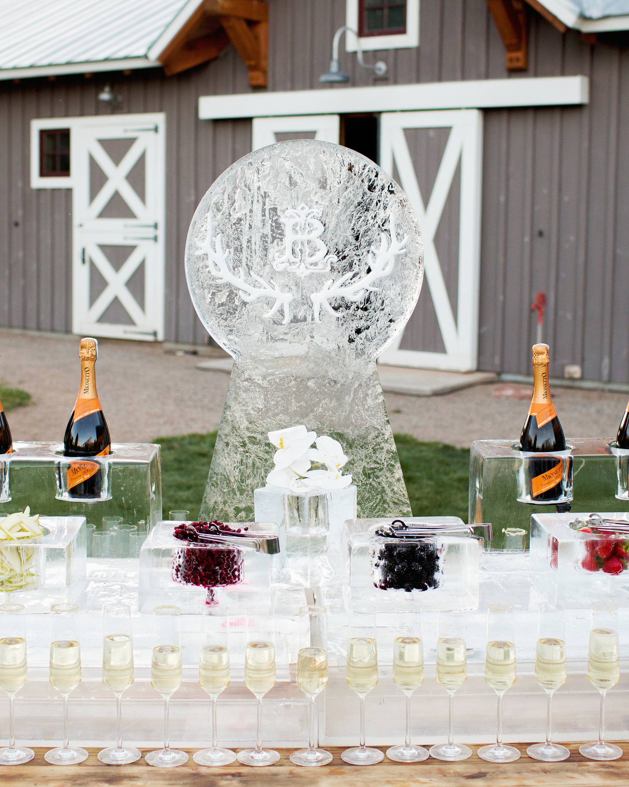 wedding ice sculpture monogrammed frozen full drink station