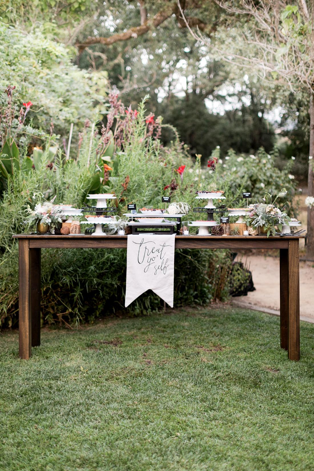 "dessert table with ""treat yo self"" sign"