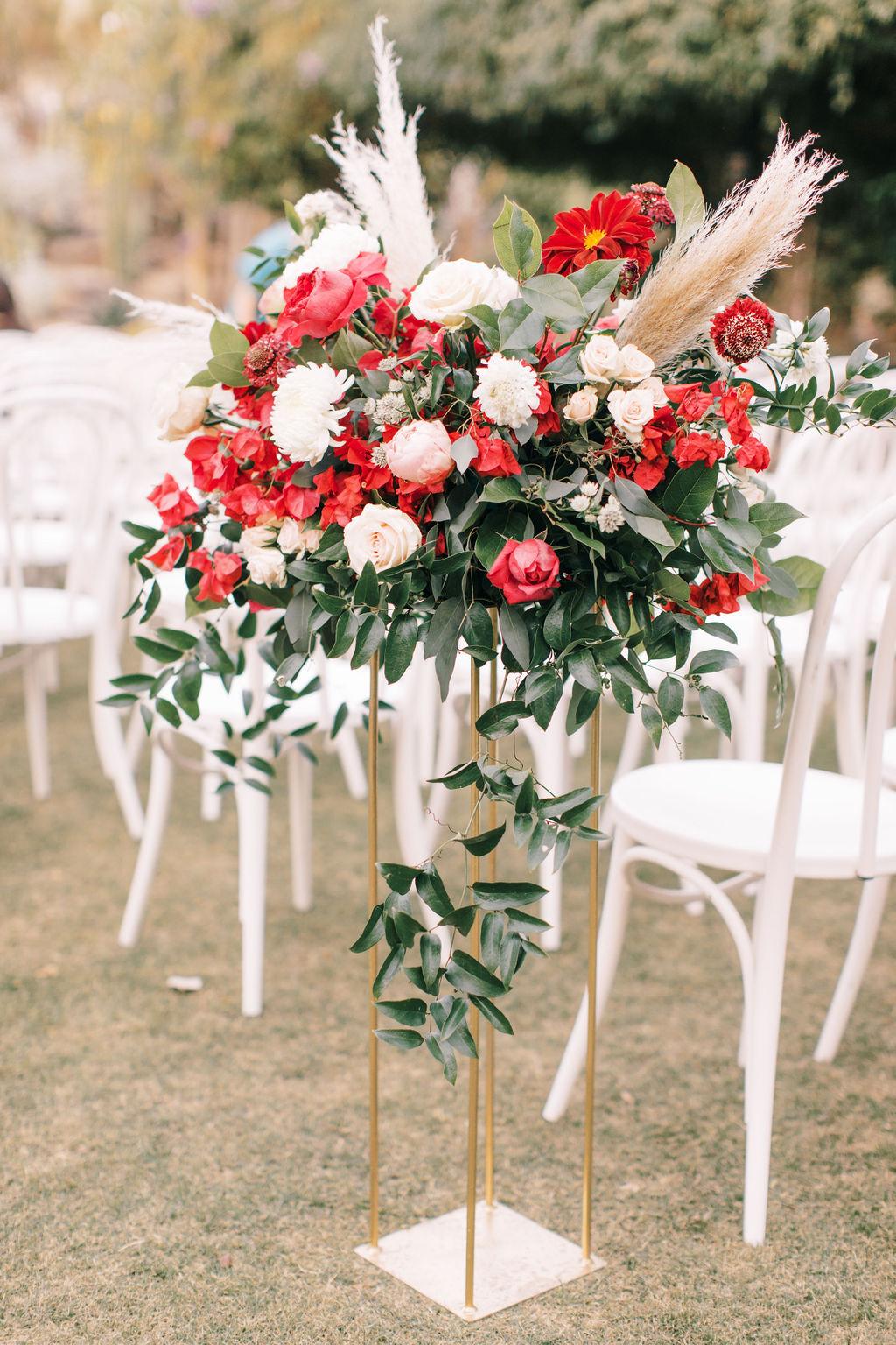 meagan robert wedding ceremony red florals