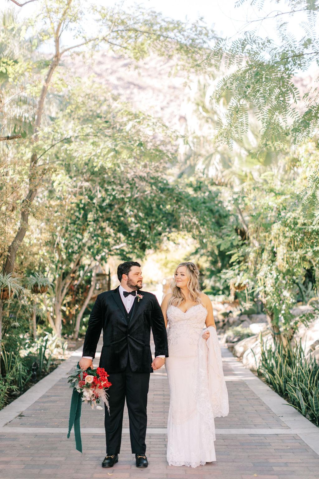 meagan robert wedding couple holding hands in courtyard