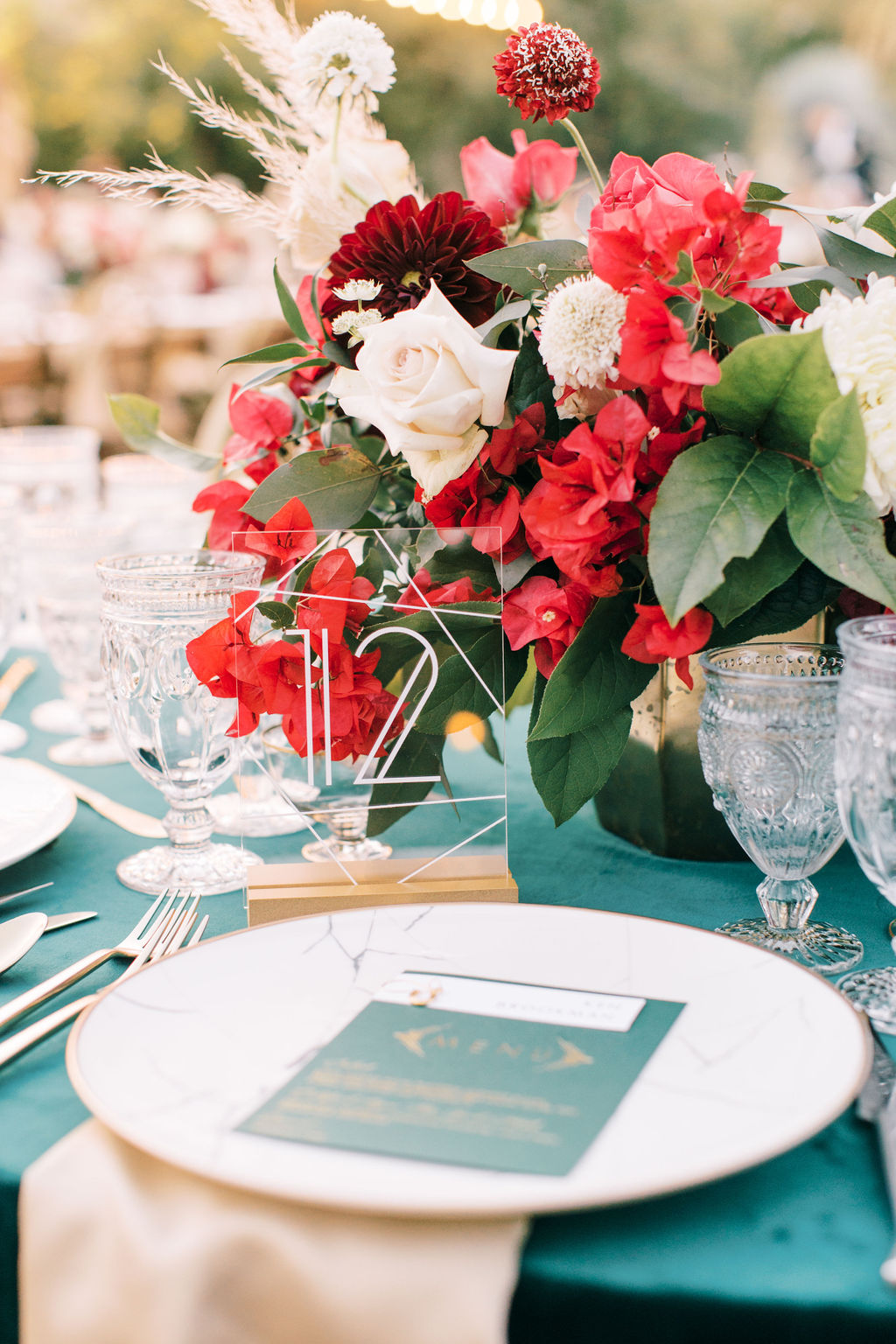 meagan robert wedding green and red place setting