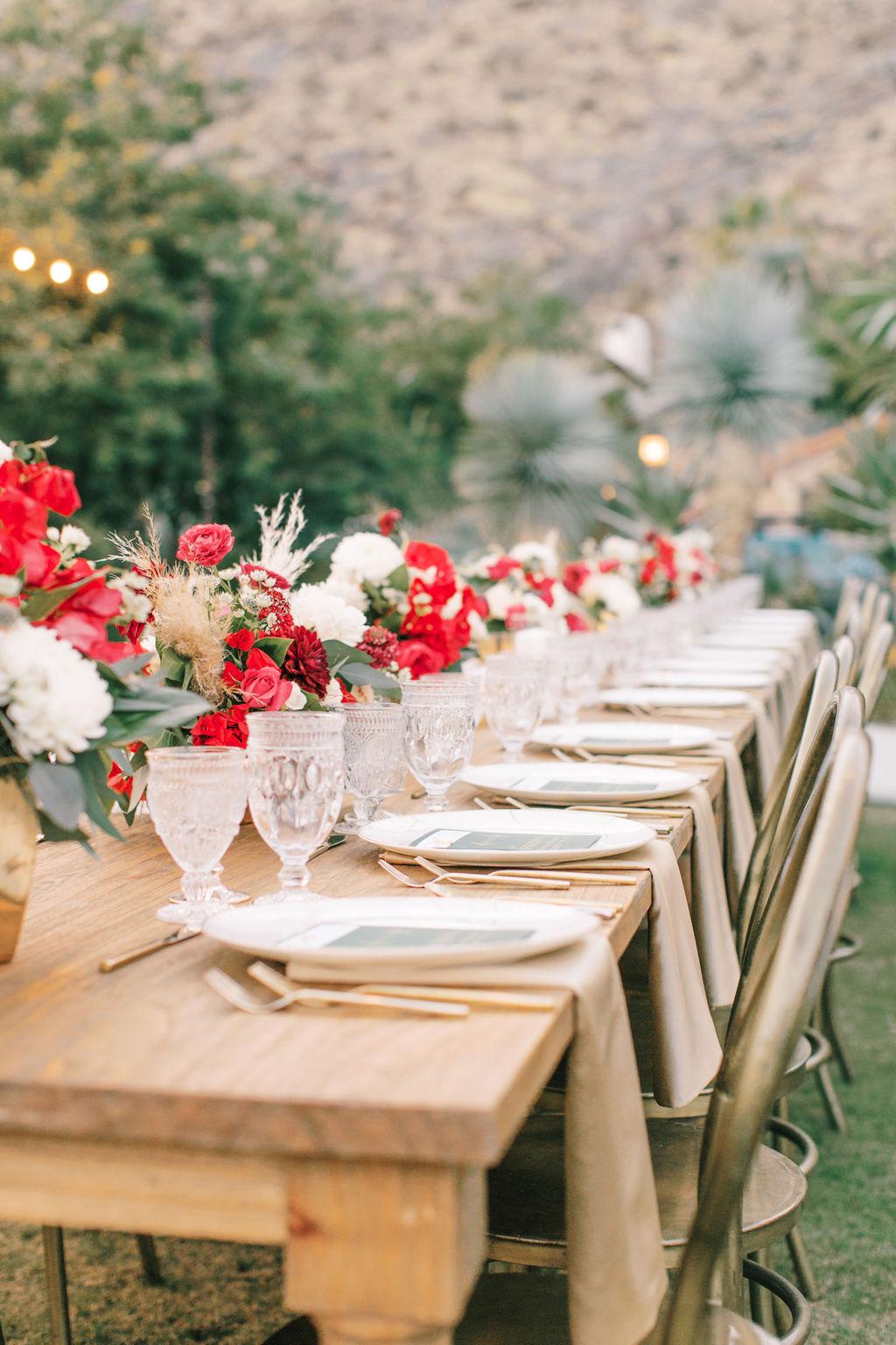 meagan robert wedding reception long wooden table
