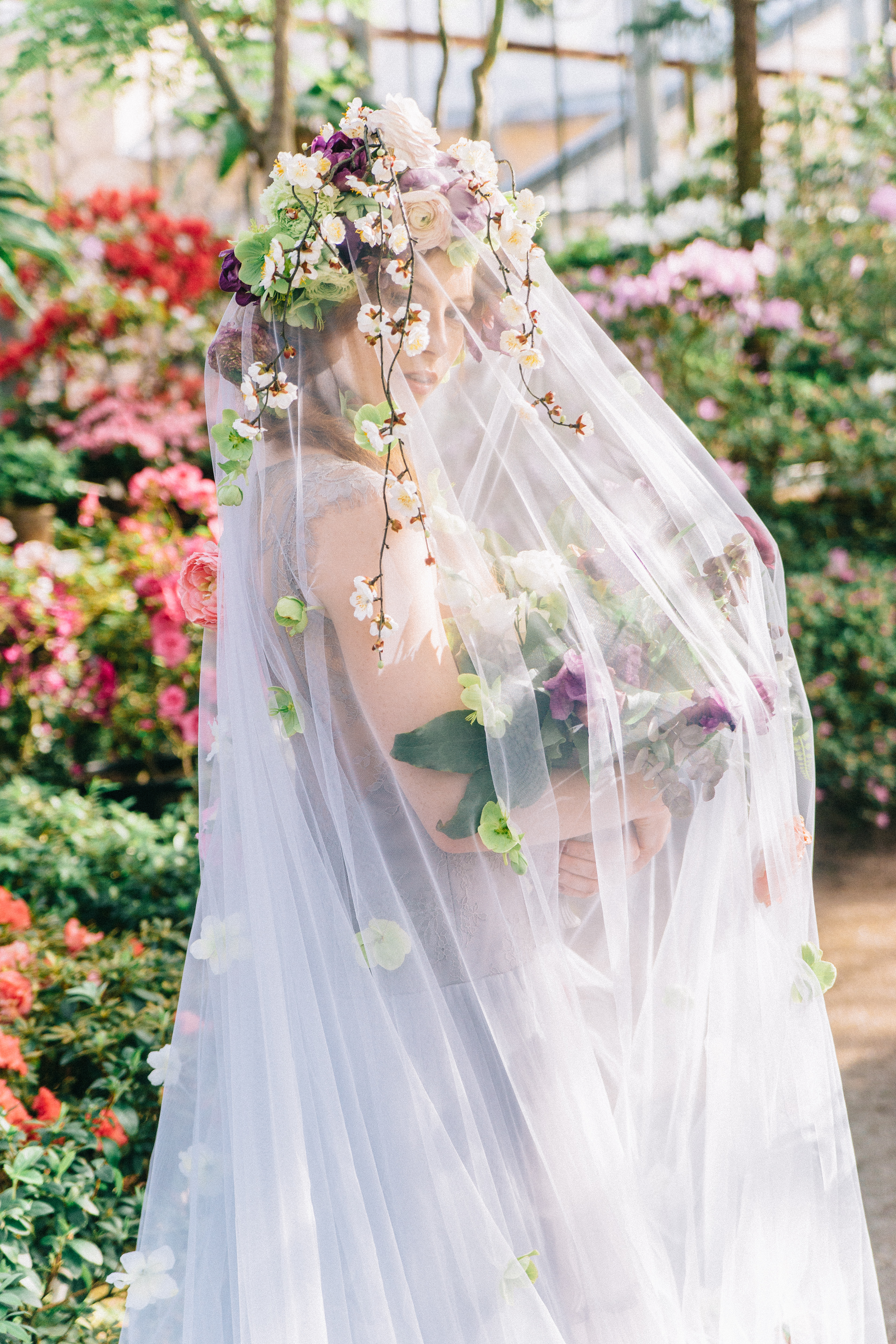 bride wearing veil with fresh flowers and flower crown