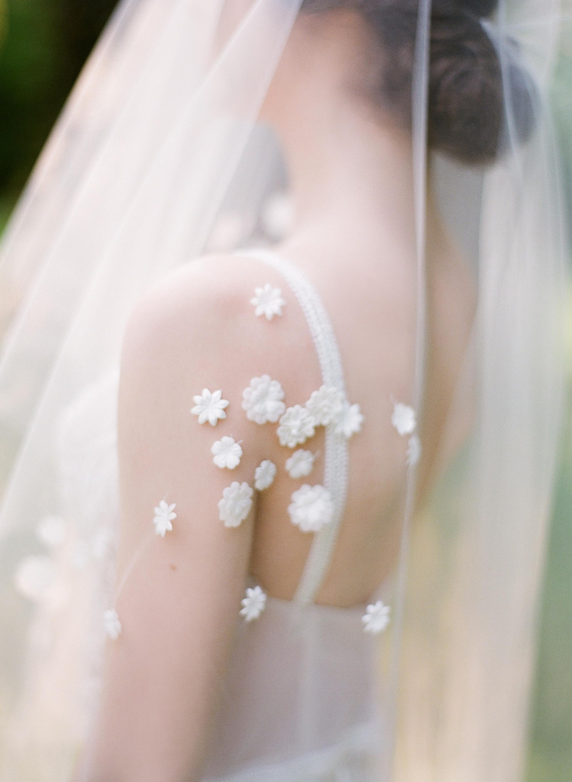 wedding veil with small floral appliqués