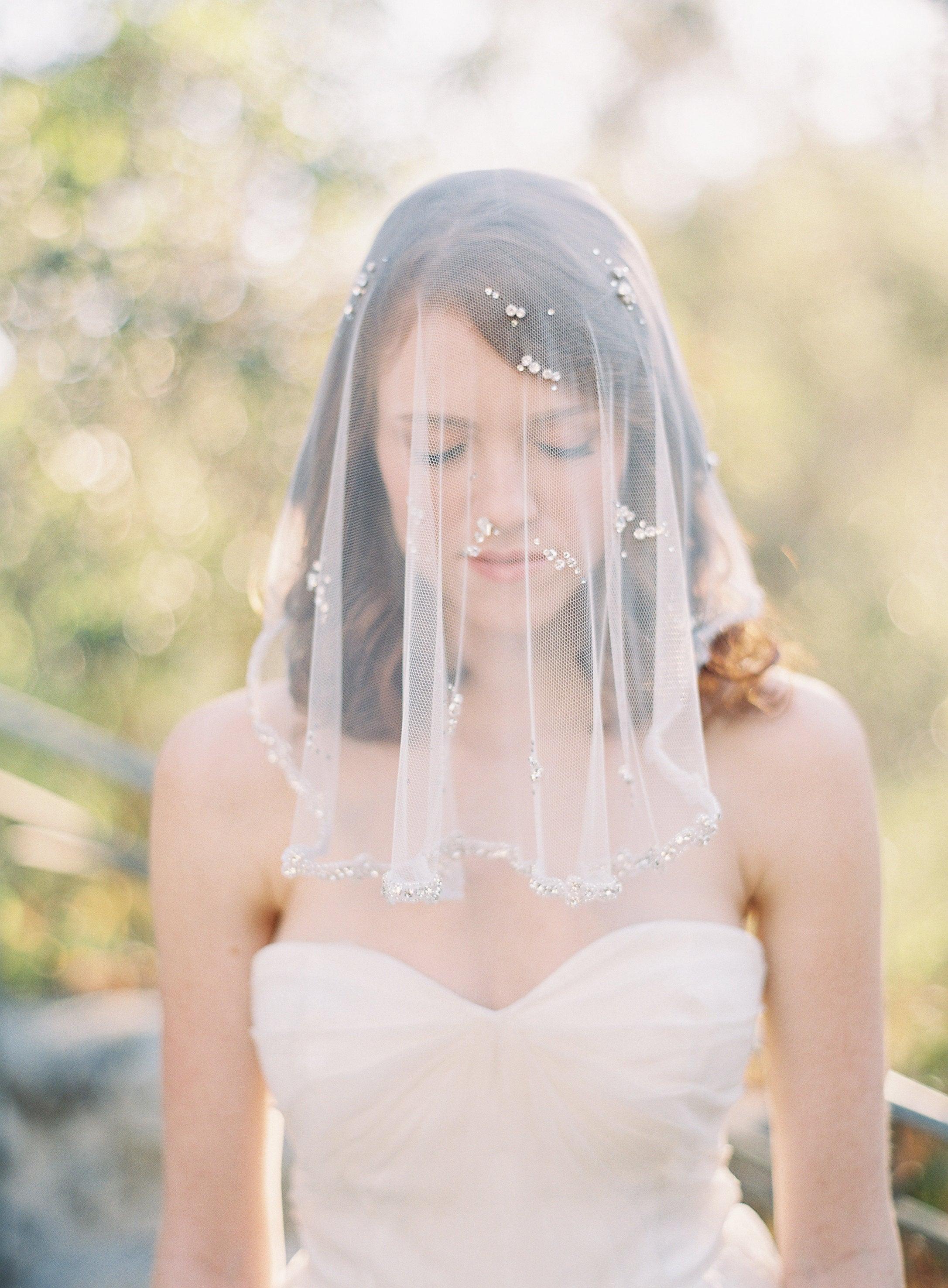 bride wearing short veil