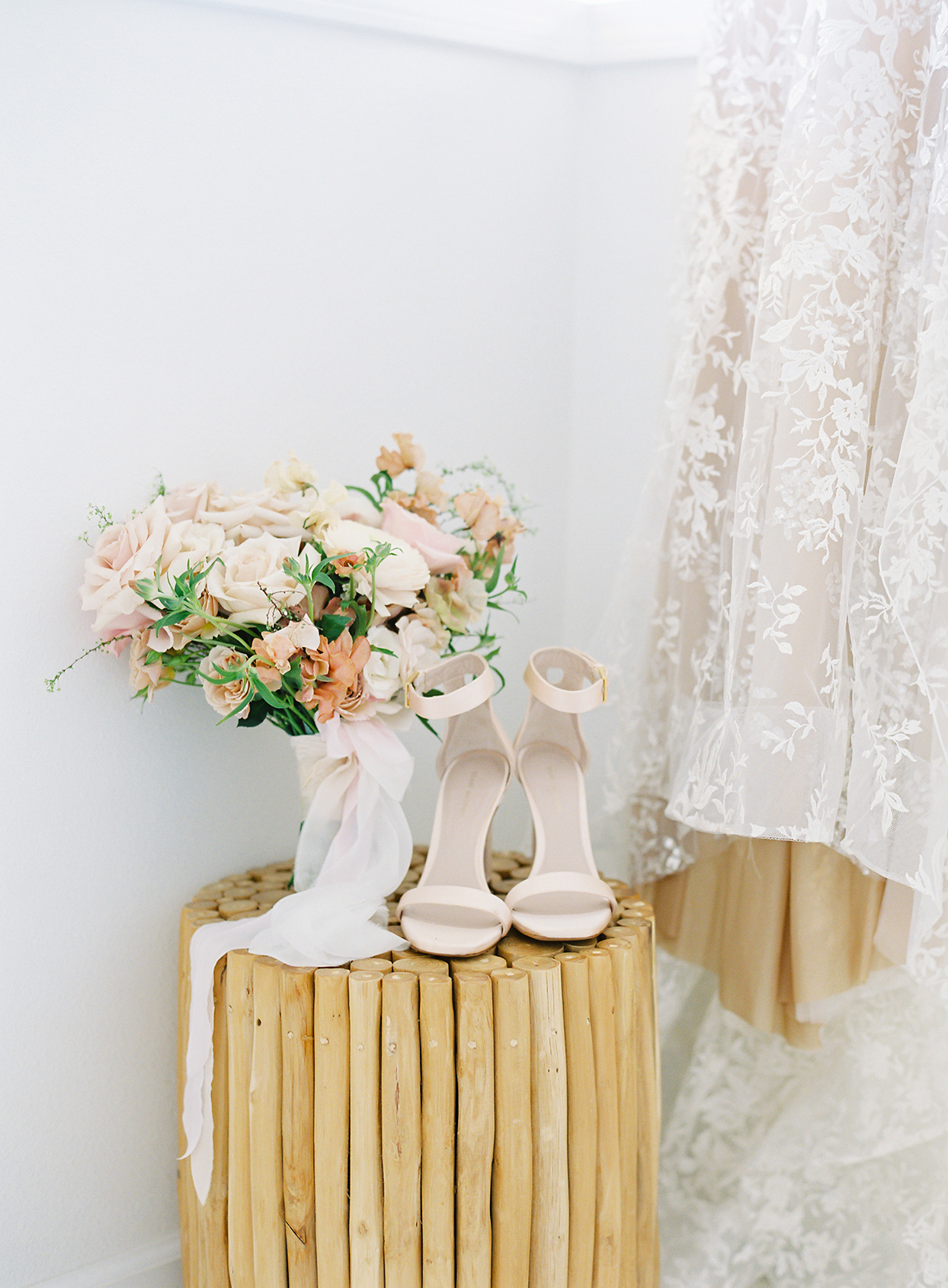 azuki sam wedding bouquet on wooden table with shoes