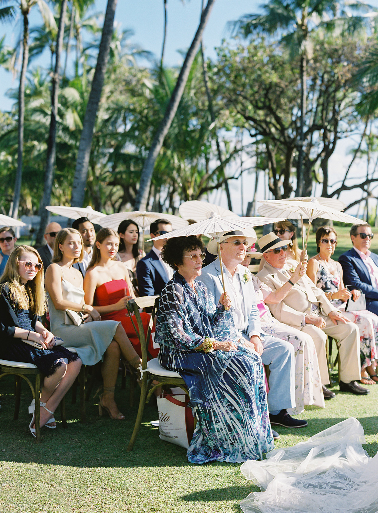 azuki sam wedding guests holding parasols during ceremony