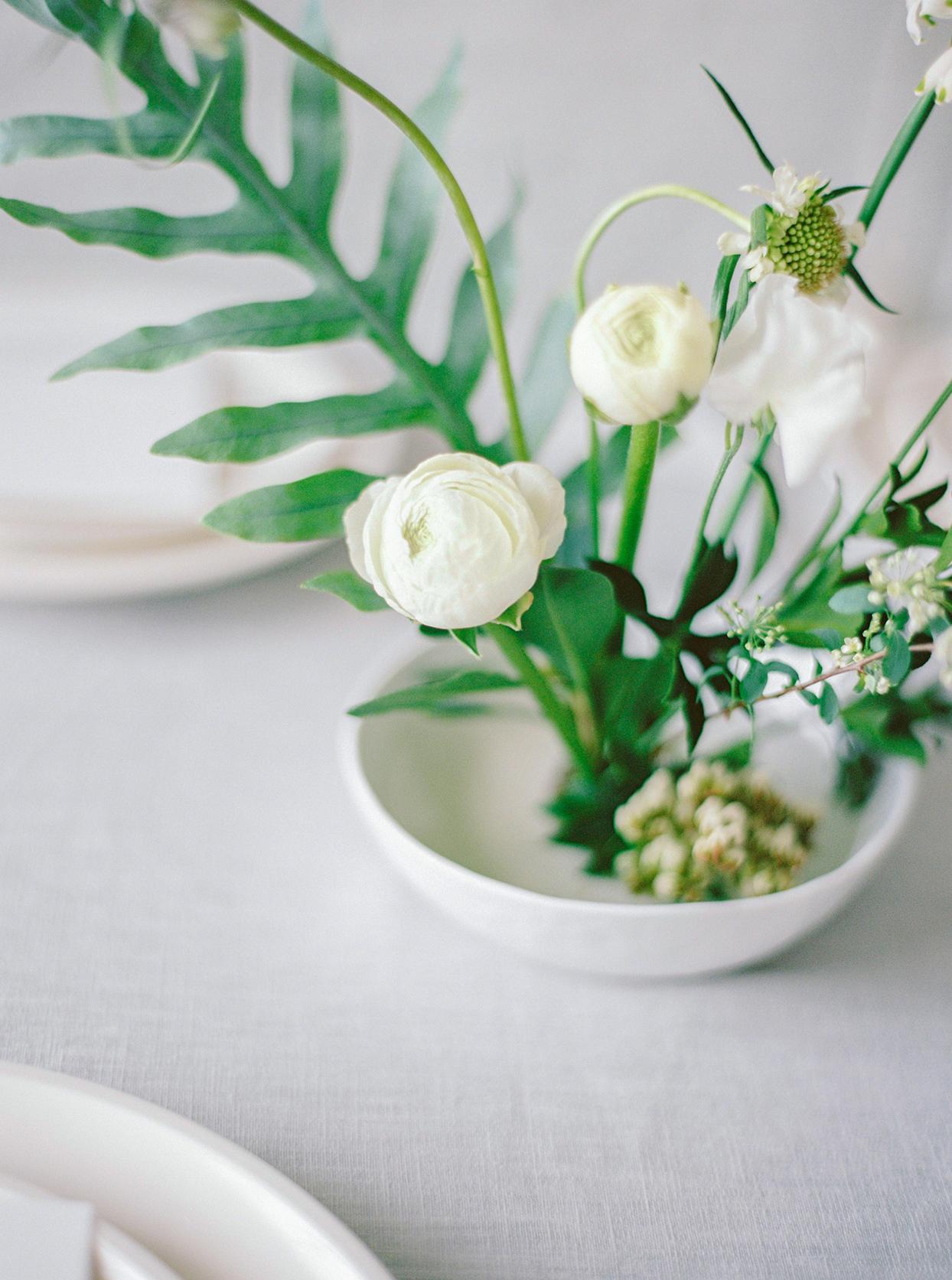 minimalist ikebana ranunculus in bowl