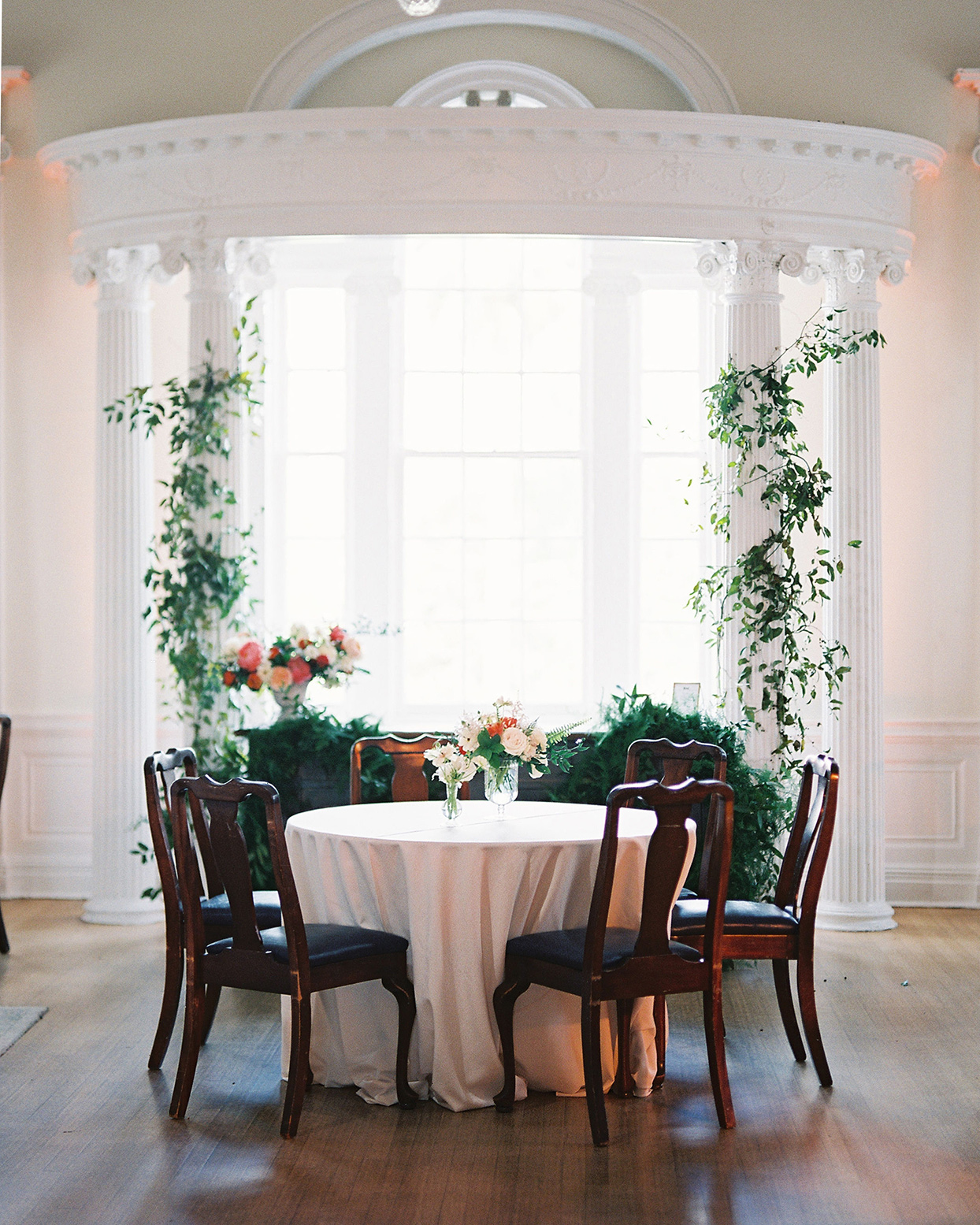 beverly steve wedding reception table in front of white window