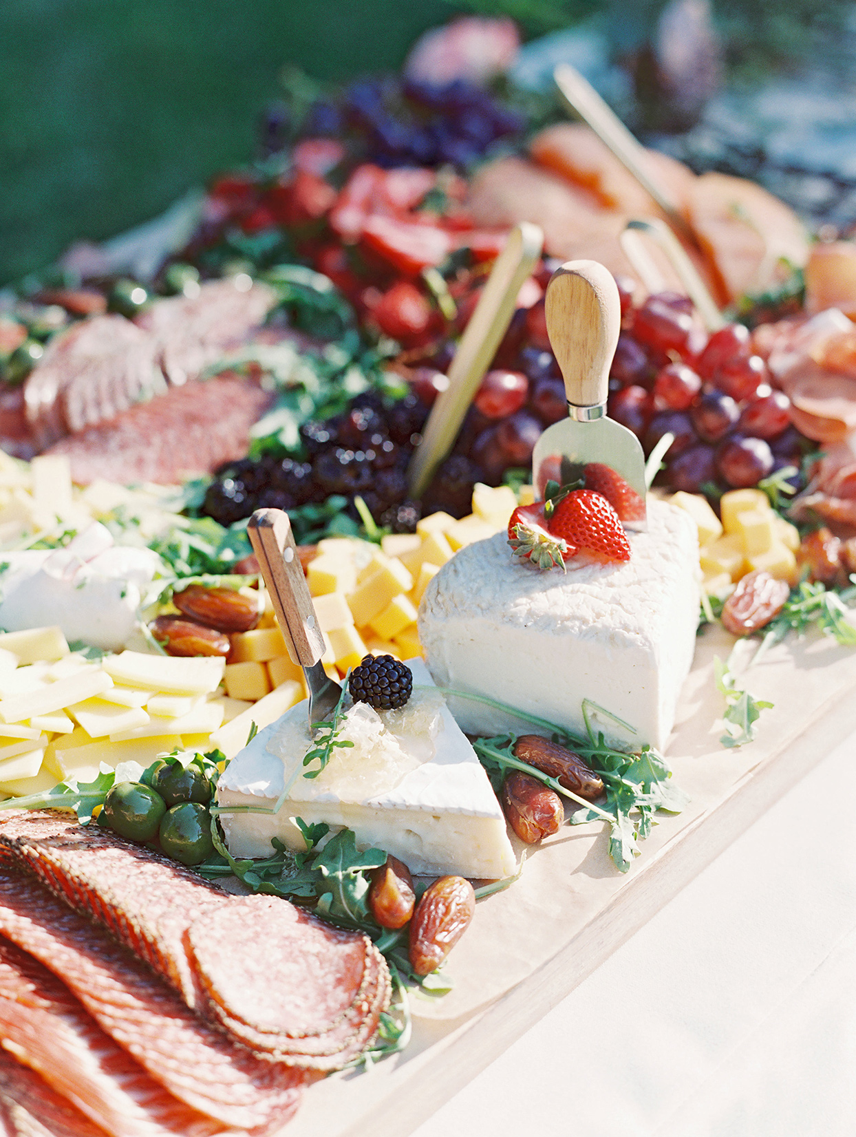 wedding grazing board with sliced wheel cheese