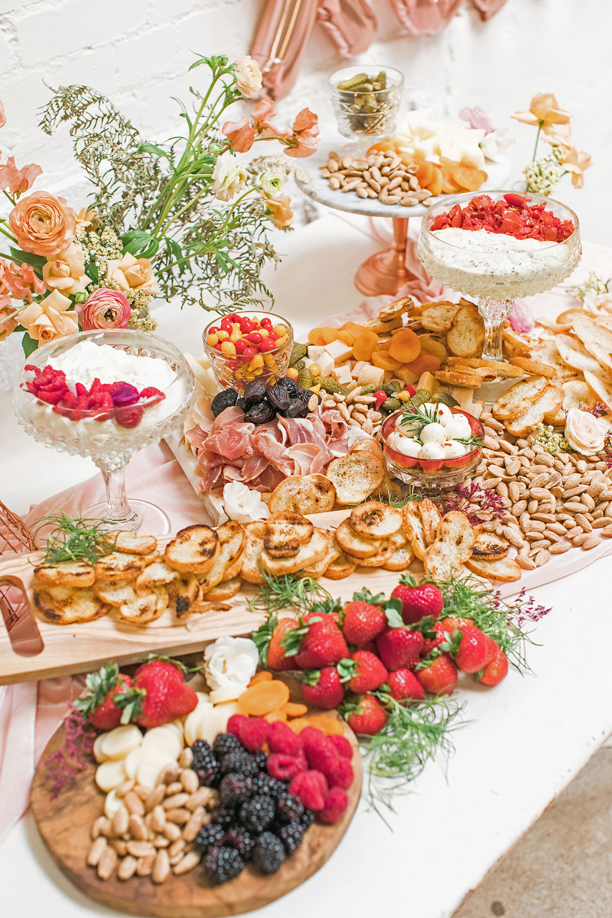 wedding grazing table with pink and peach floral decor