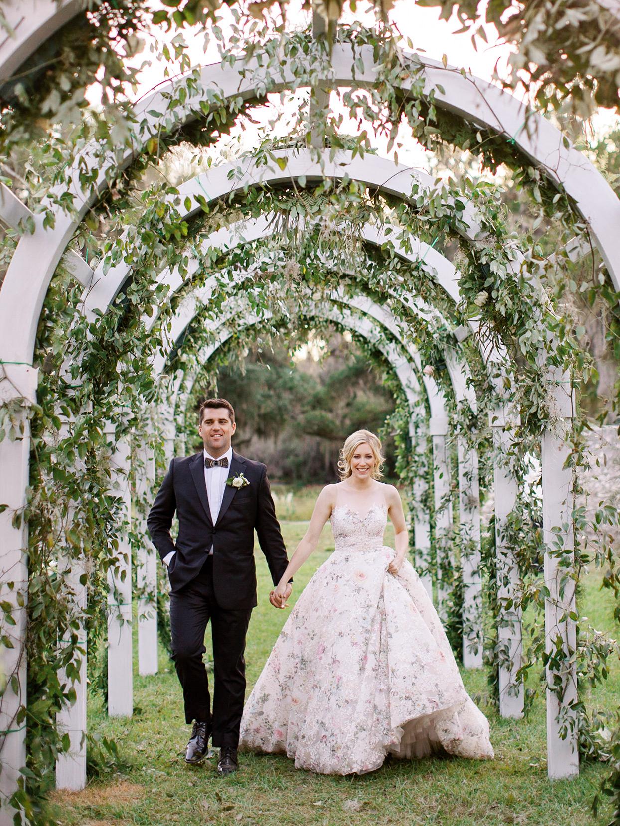 chelsea john wedding couple under white garden archway